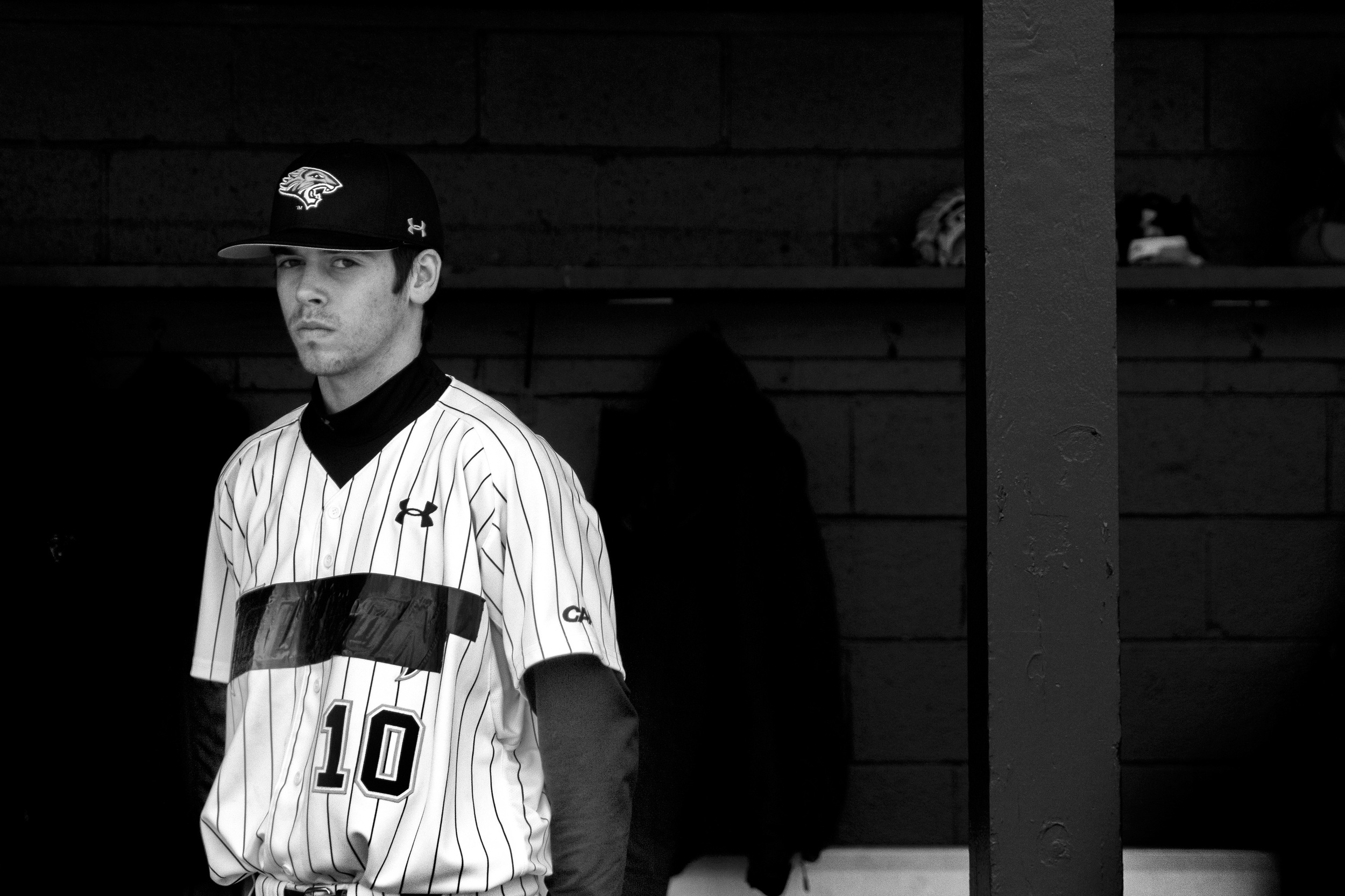 Towson University pitcher David Sapp makes eye contact with media members during a home game on March 8, 2013 in Baltimore, Md.