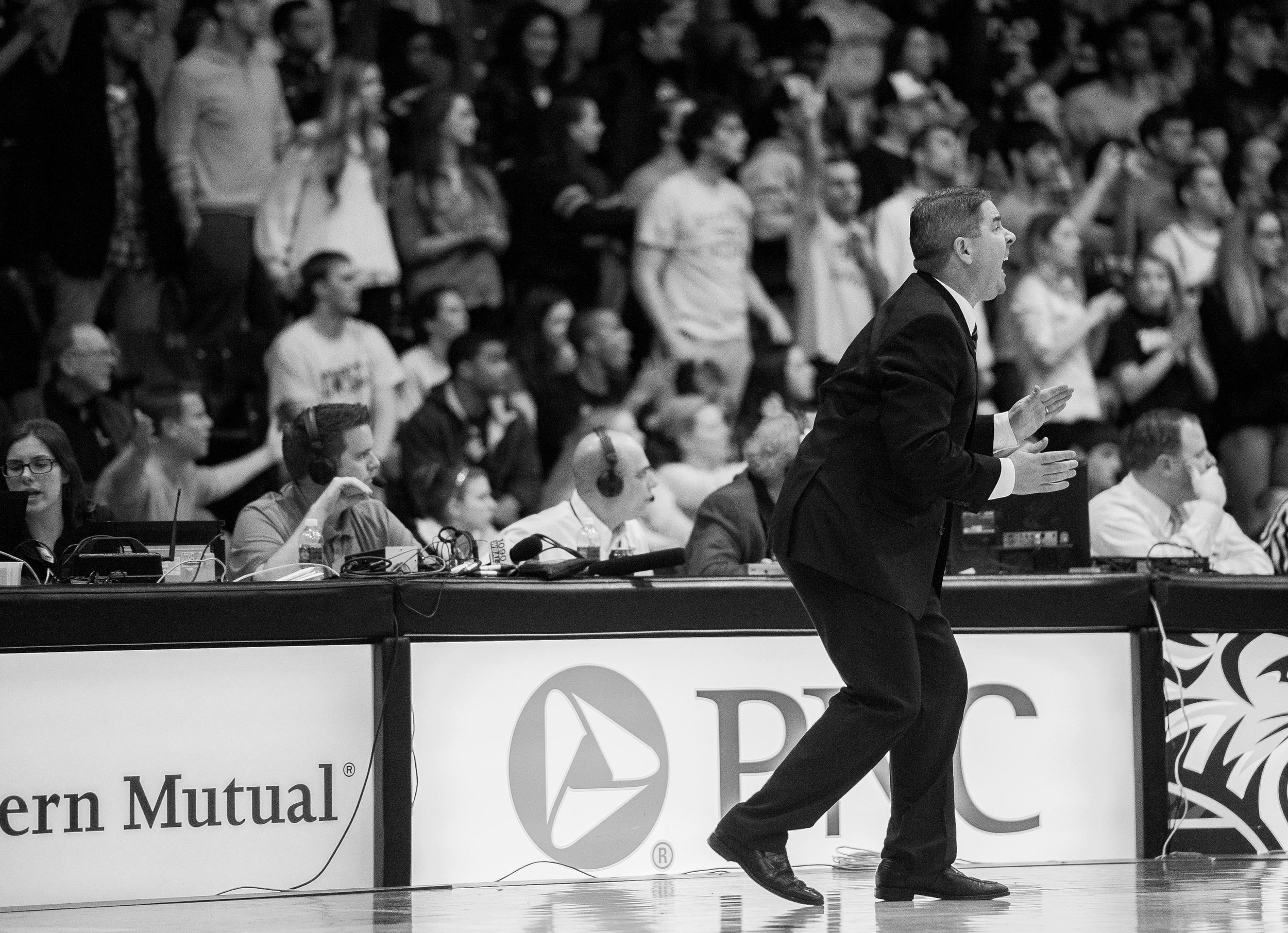 Towson University men's basketball head coach Pat Skerry screams across the court while the clock runs short during the last game of their 2012-2013 season on March 2, 2013 in Baltimore, Md.