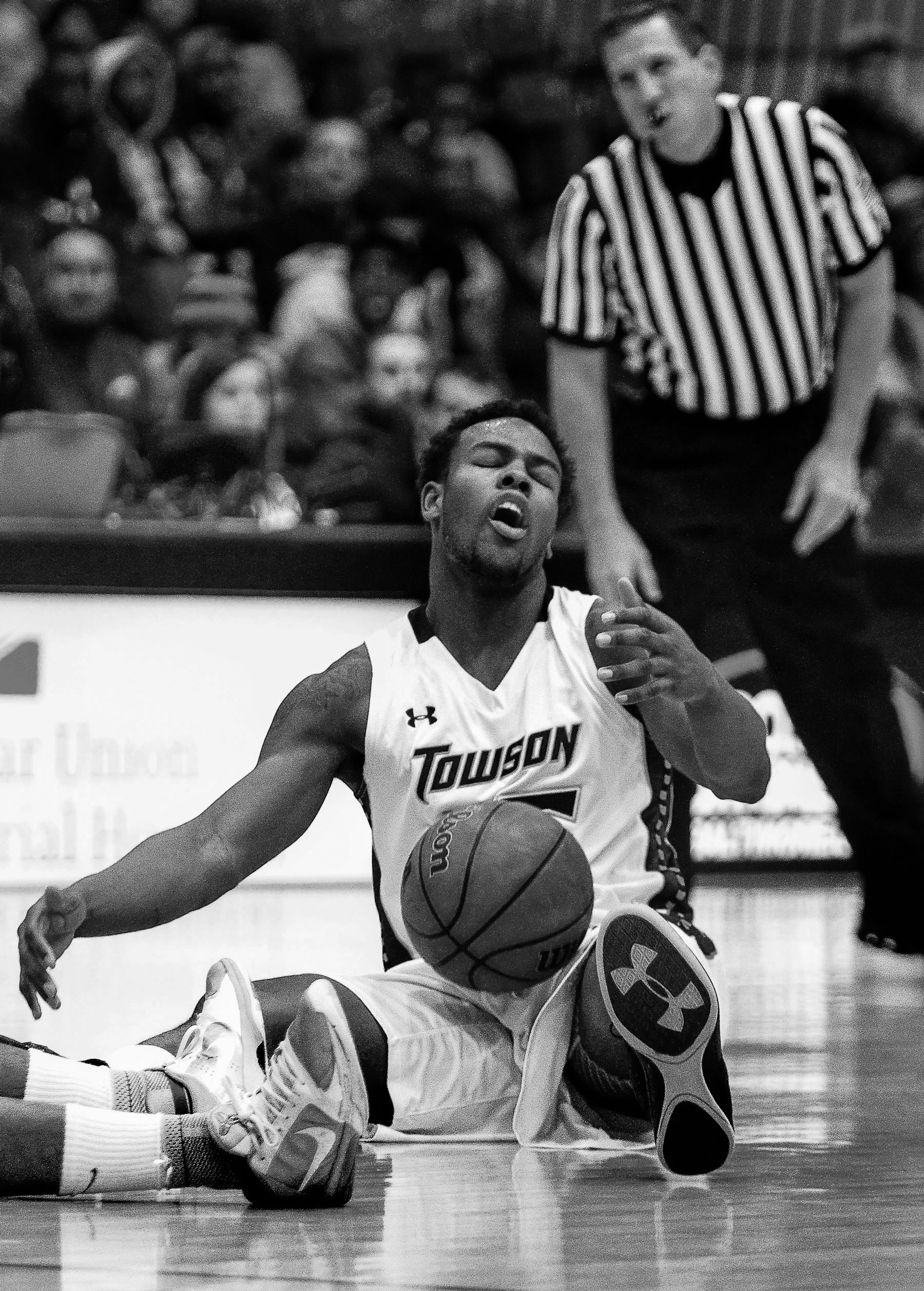 Towson University forward  Timajh Parker-Rivera reacts to a foul during a home game against George  Mason University on Jan. 23, 2013.