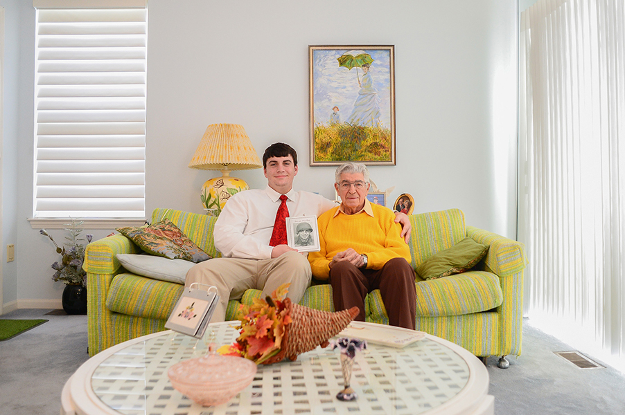 United States Army veteran Fred Petrogallo (right) and his grandson, Connor McAnallen (left), pose while holding a book McAnallen wrote when he was 10 in Columbia, Md. on Nov. 1, 2013. The book showcases different aspects about Petrogallo's experience during World War II.