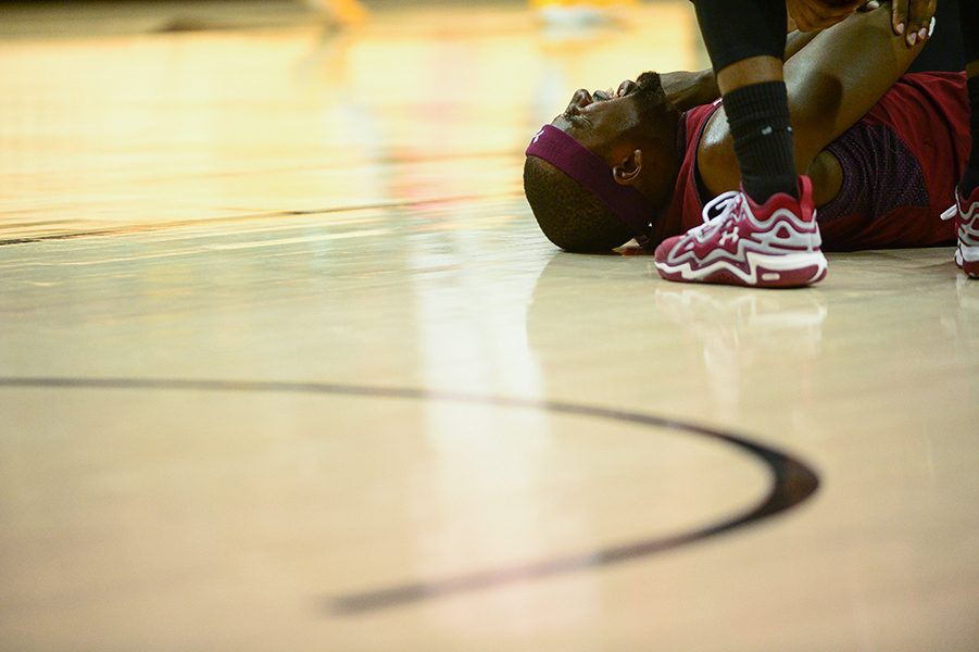 Temple University forward Anthony Lee yells in pain after falling on his elbow during a match up against Towson University in SECU Arena, on Nov. 14, 2013. Lee would return to the game and finish out with 20 points but Temple would inevitably fall short losing 69-75.