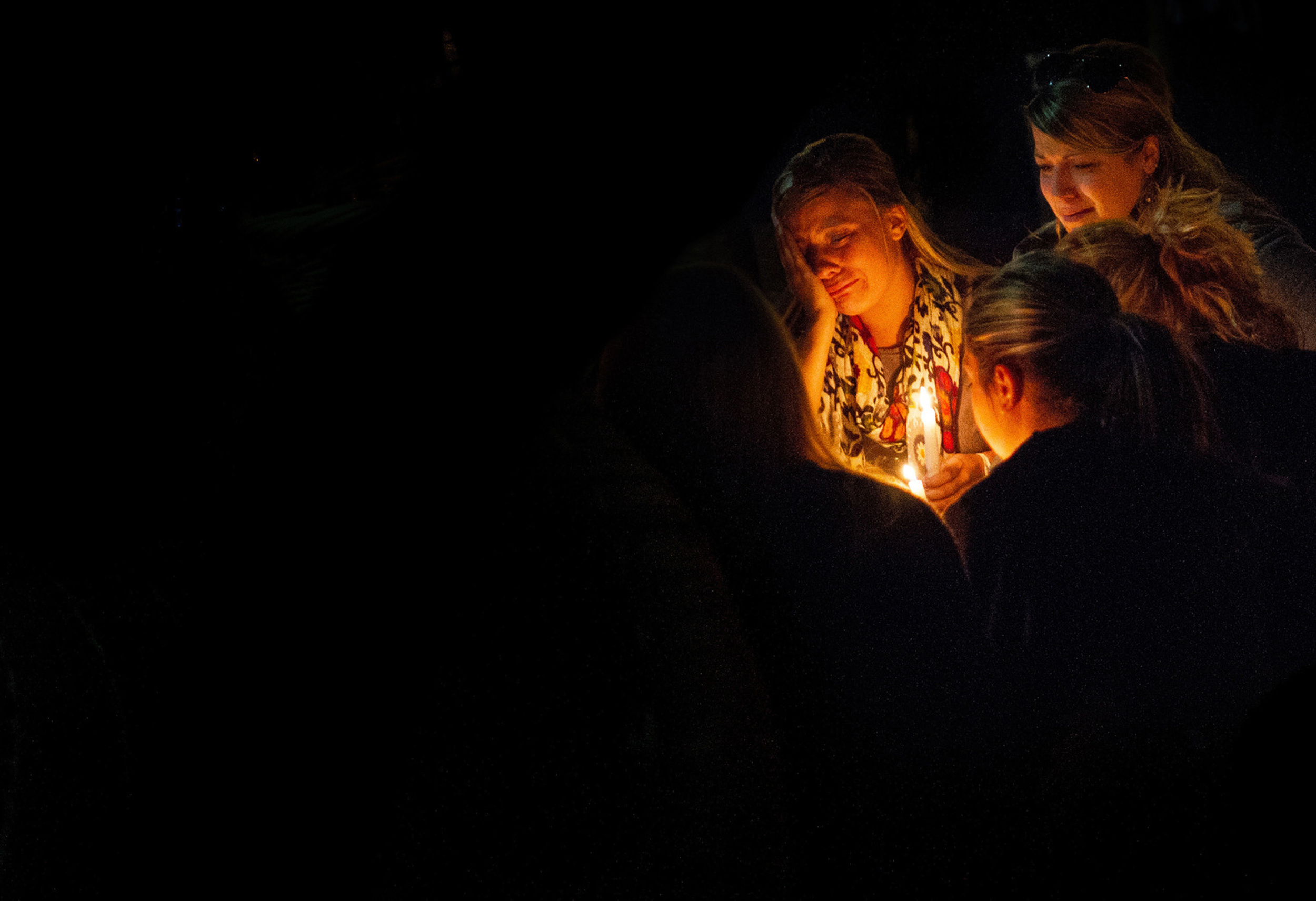 Towson University students gather together to mourn the death of two fraternity members who died over the same weekend in two separate incidents on March 31, 2012 in Baltimore, Maryland.