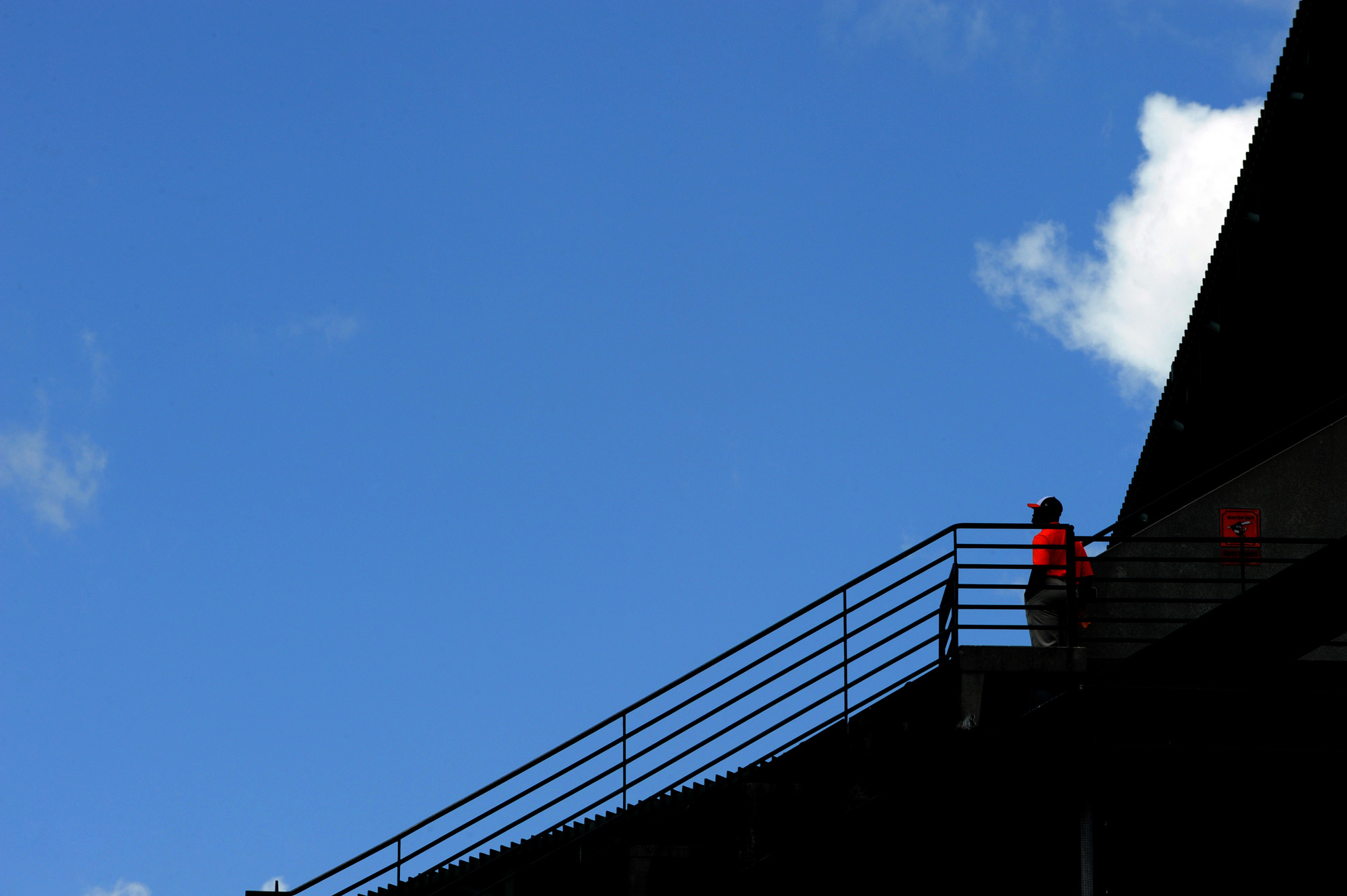 An Oriole Park employee looks out at the field before a home game starts on Aug. 4, 2013 at Oriole Park at Camden Yards in Baltimore, Md.