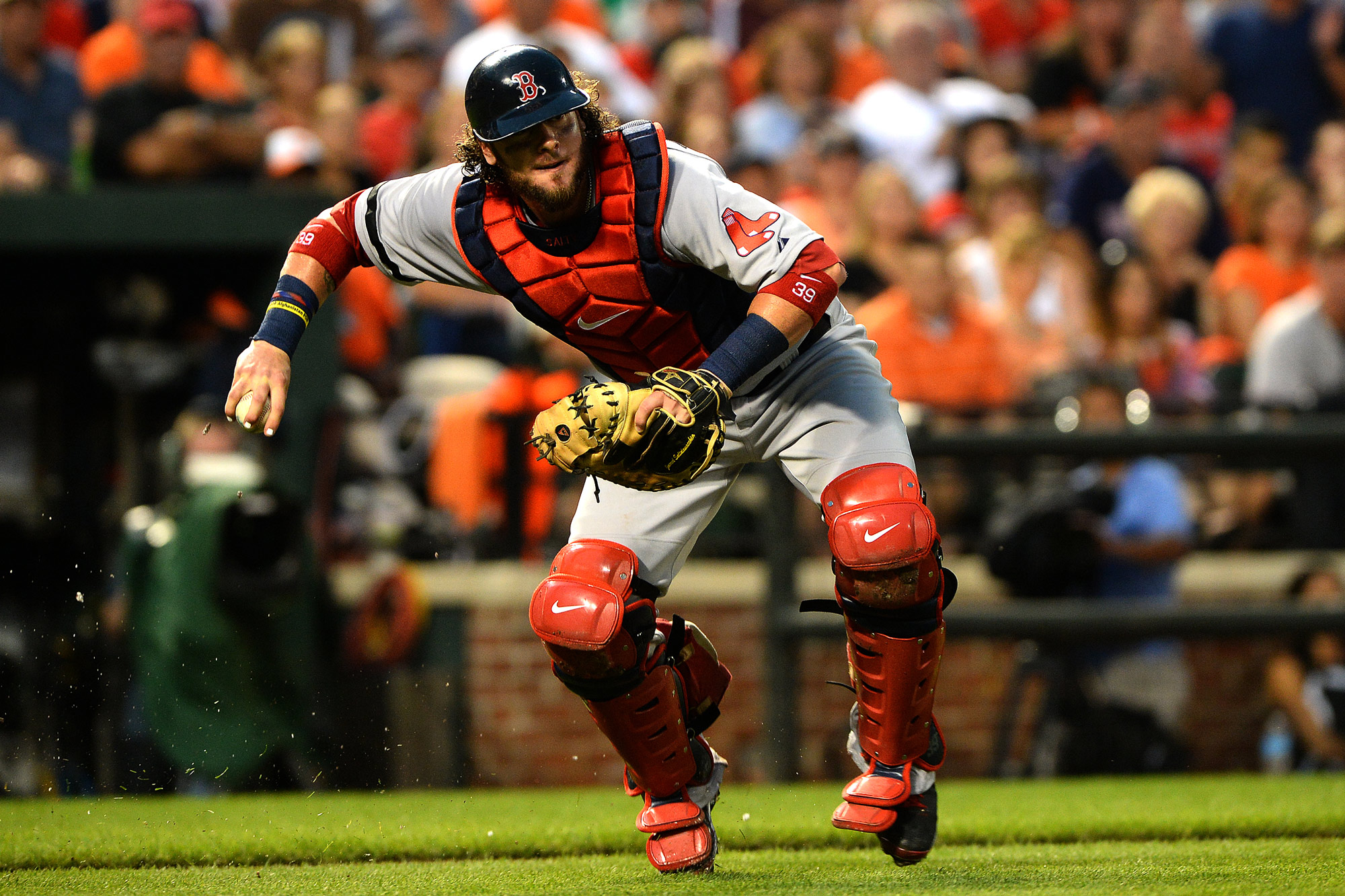 Boston Red Sox catcher Jarrod Saltalamaccia makes a routine out at first during a game against the Baltimore Orioles on July 27, 2013 at Oriole Park at Camden Yards in Baltimore, Md.