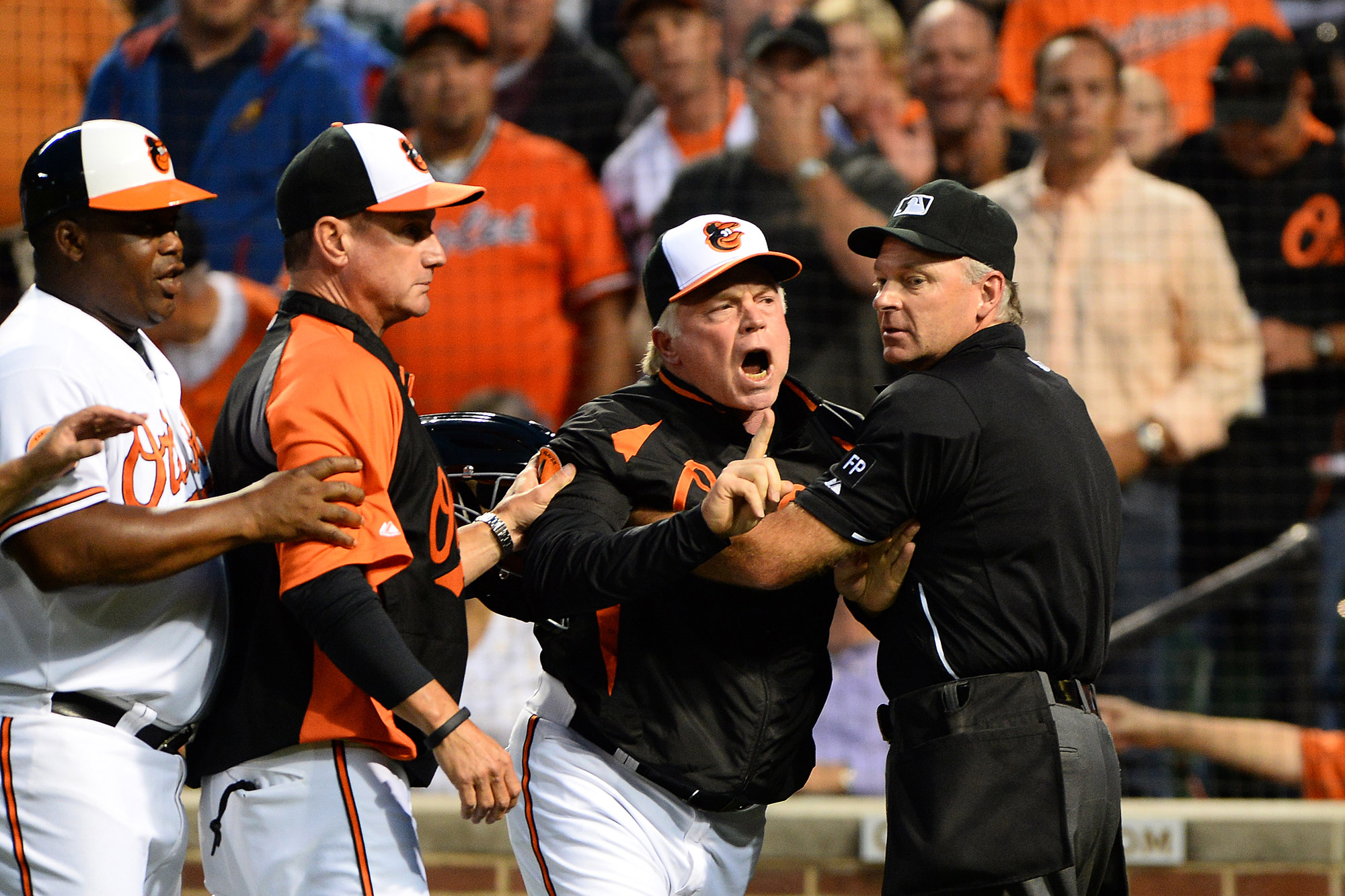 Baltimore Orioles manager Buck Showalter yells over a call on Sept. 9, 2013 at Oriole Park at Camden Yards in Baltimore, Md.