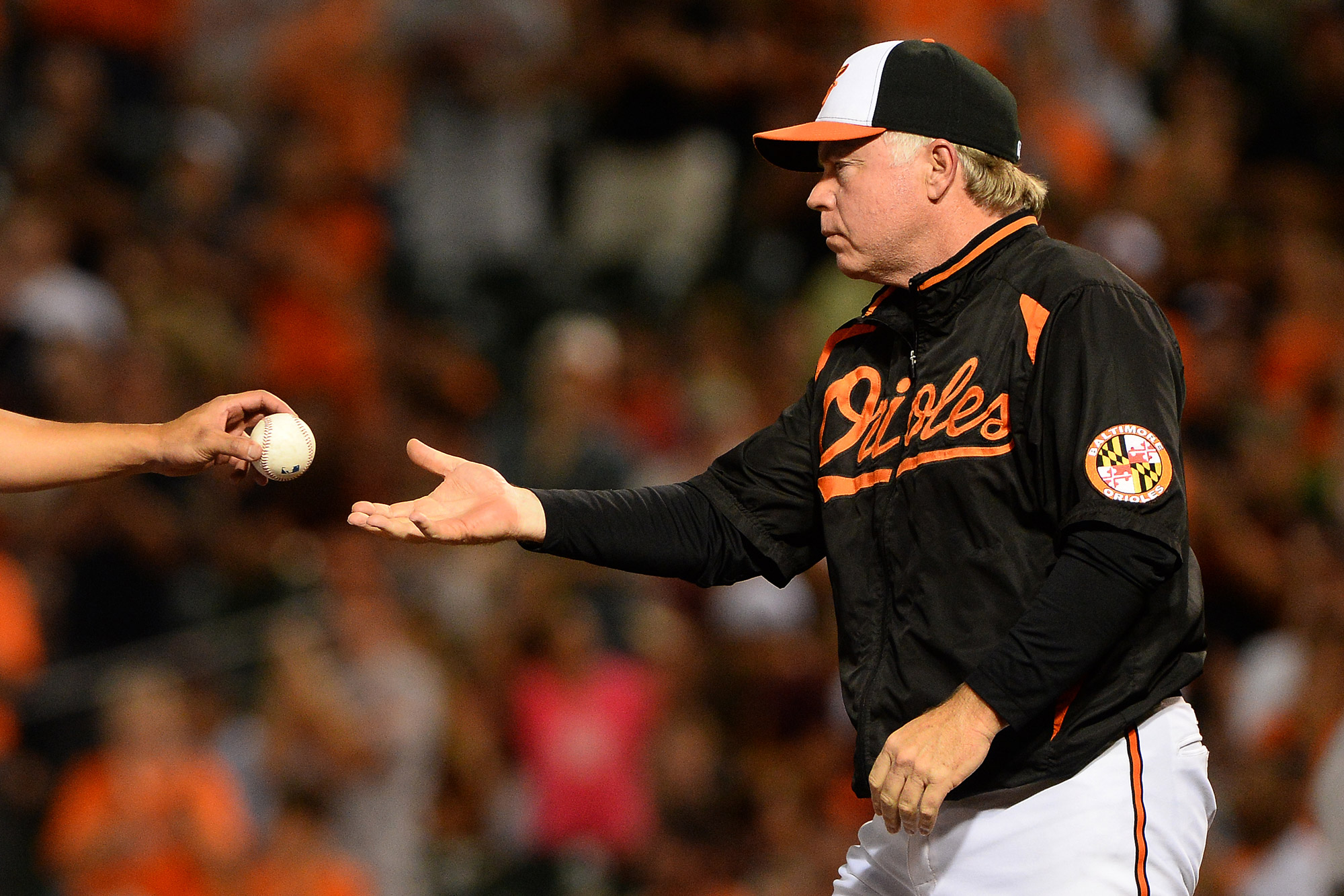 Baltimore Orioles manager Buck Showalter takes the ball from pitcher Wei-Yin Chen after pulling him out of the game in 6th inning on July 30, 2013 at Oriole Park at Camden Yards in Baltimore, Md.