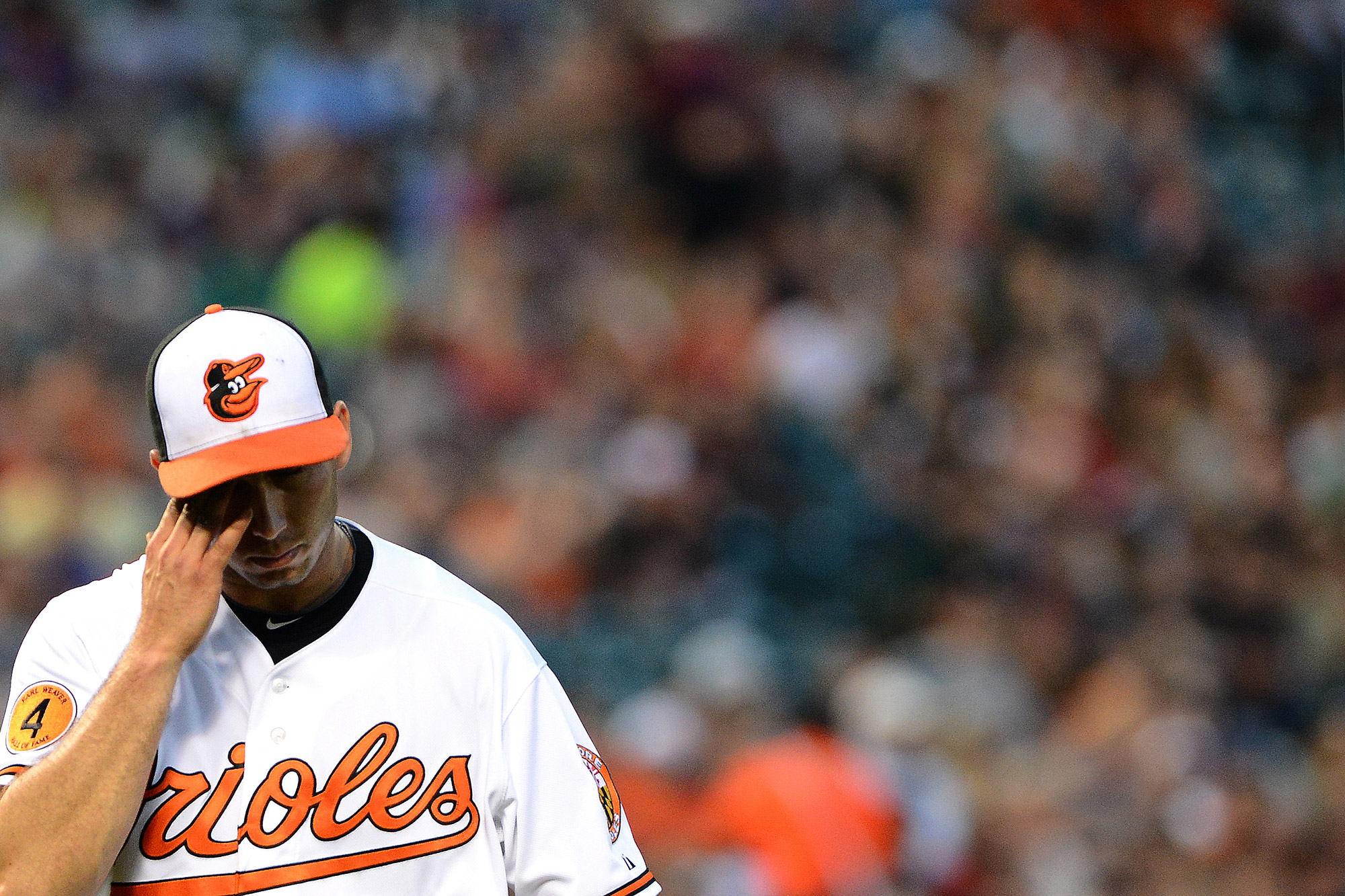 Baltimore Orioles pitcher Miguel Gonzalez wipes his brow after being pulled from the game in the 5th inning on May 21, 2013 at Oriole Park at Camden Yards in Baltimore, Md.