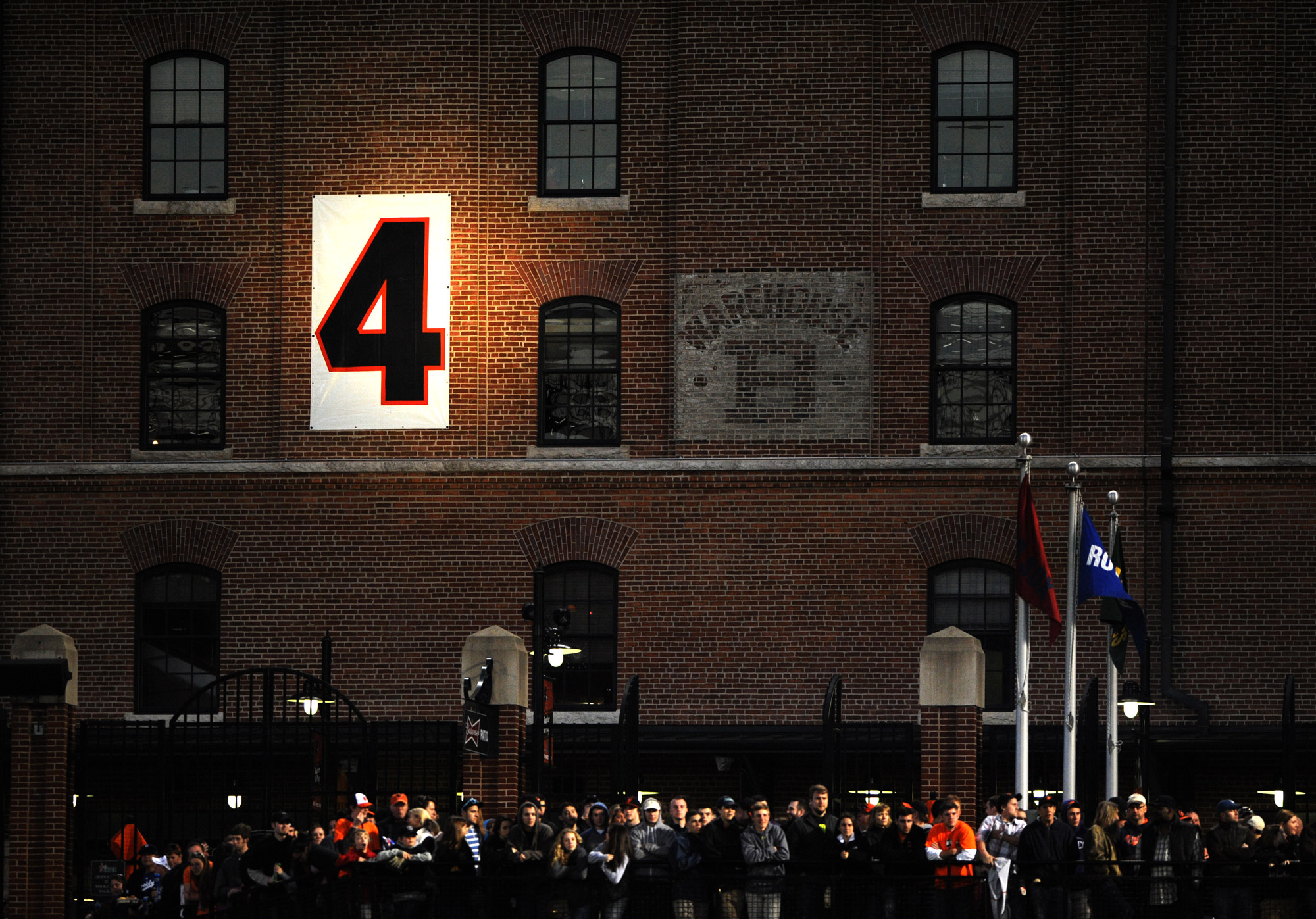 The number four of the late Earl Weaver is displayed on the side of the warehouse at Oriole Park at Camden Yards during a celebration of the coach's life on April 20, 2013 in Baltimore, Md.