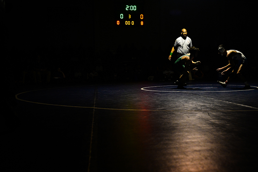 Nathan Ganey, left, of Sparrows Point, works against Nick Villa, right, of Arundel during their 106 pound weight bout match at the Franklin Invitational on Jan. 18, 2014.