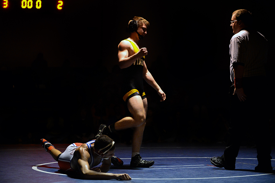 Samen Boulos, left, of Centennial struggles to get up while Connor Strunk, right, of Mt. Hebron celebrates after winning their 152 pound weight bout match at the Franklin Invitational on Jan. 18, 2014.