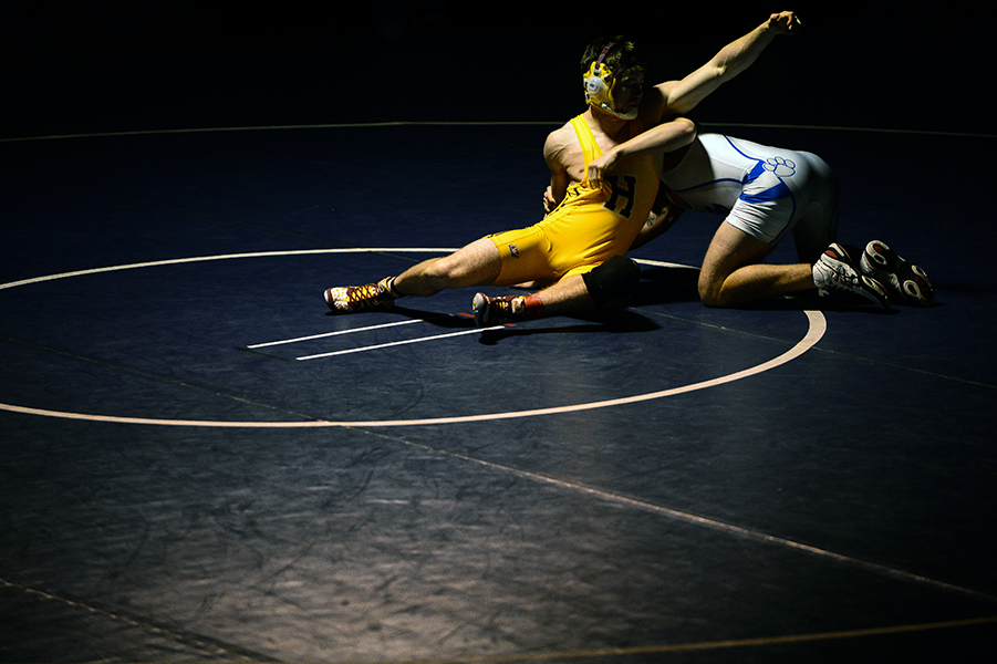 Dylan Gray, left, of Hereford, breaks away from Eric Marrin, right, of Sparrows Point during their 160 pound weight bout match at the Franklin Invitational on Jan. 18, 2014.