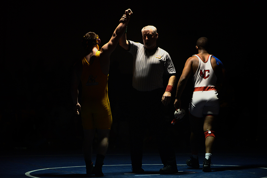 Malik Smith, right, of North County walks off the mat while Joe Miller, left, of Hereford is recognized as the winner after their 182 pound weight bout match at the Franklin Invitational on Jan. 18, 2014.