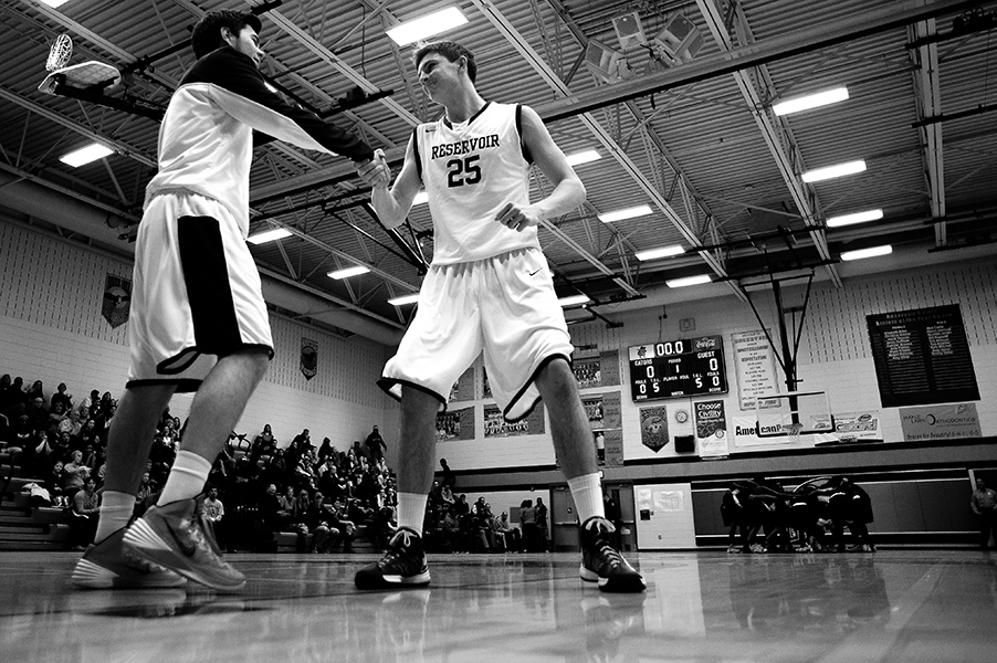 Forward Alex Hedgren, right, of Reservoir High School is introduced before a game against Oakland Mills High School on Jan. 25, 2014.