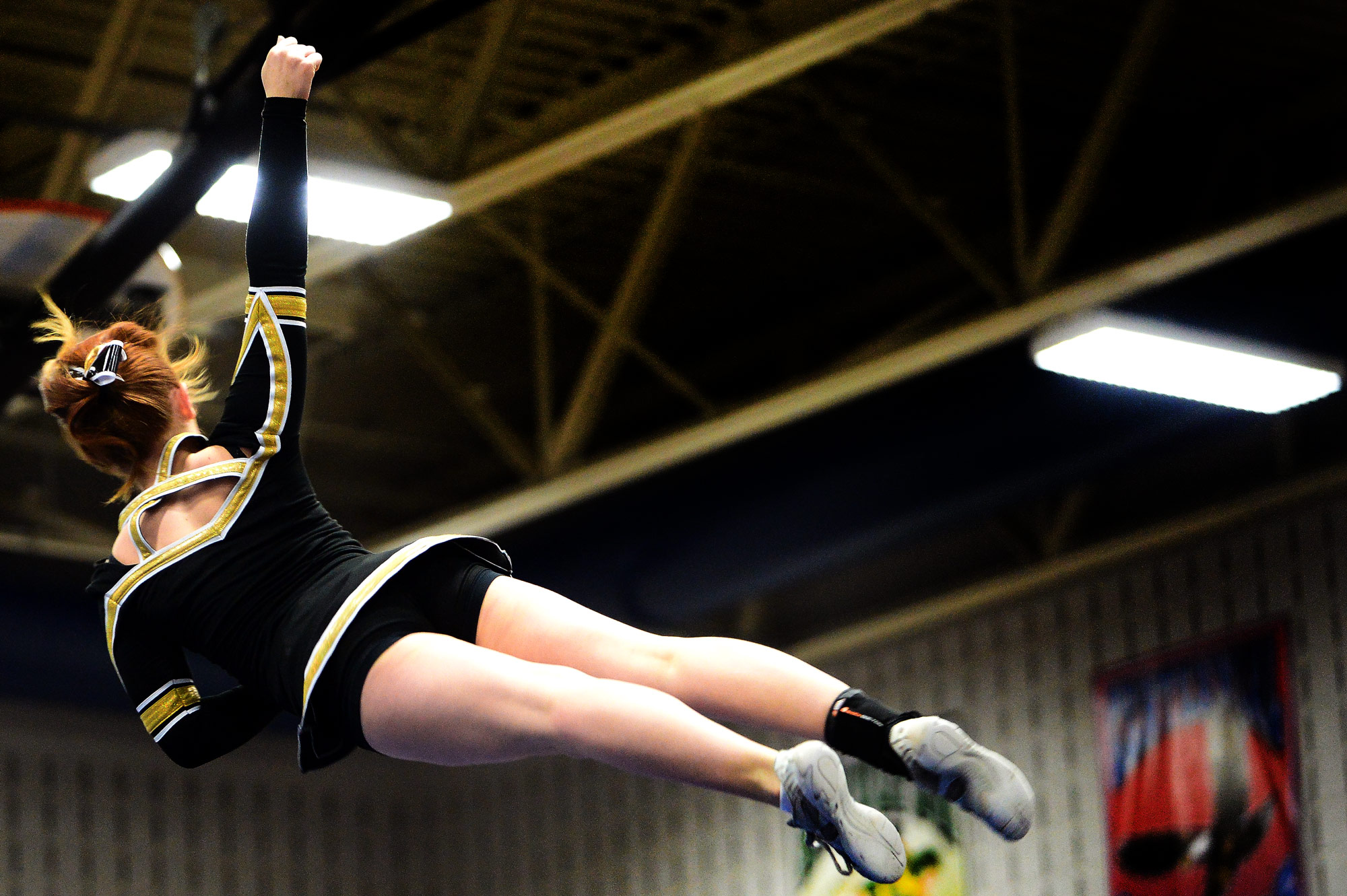 Mount Hebron sophomore Emily Turner is flips through the air.