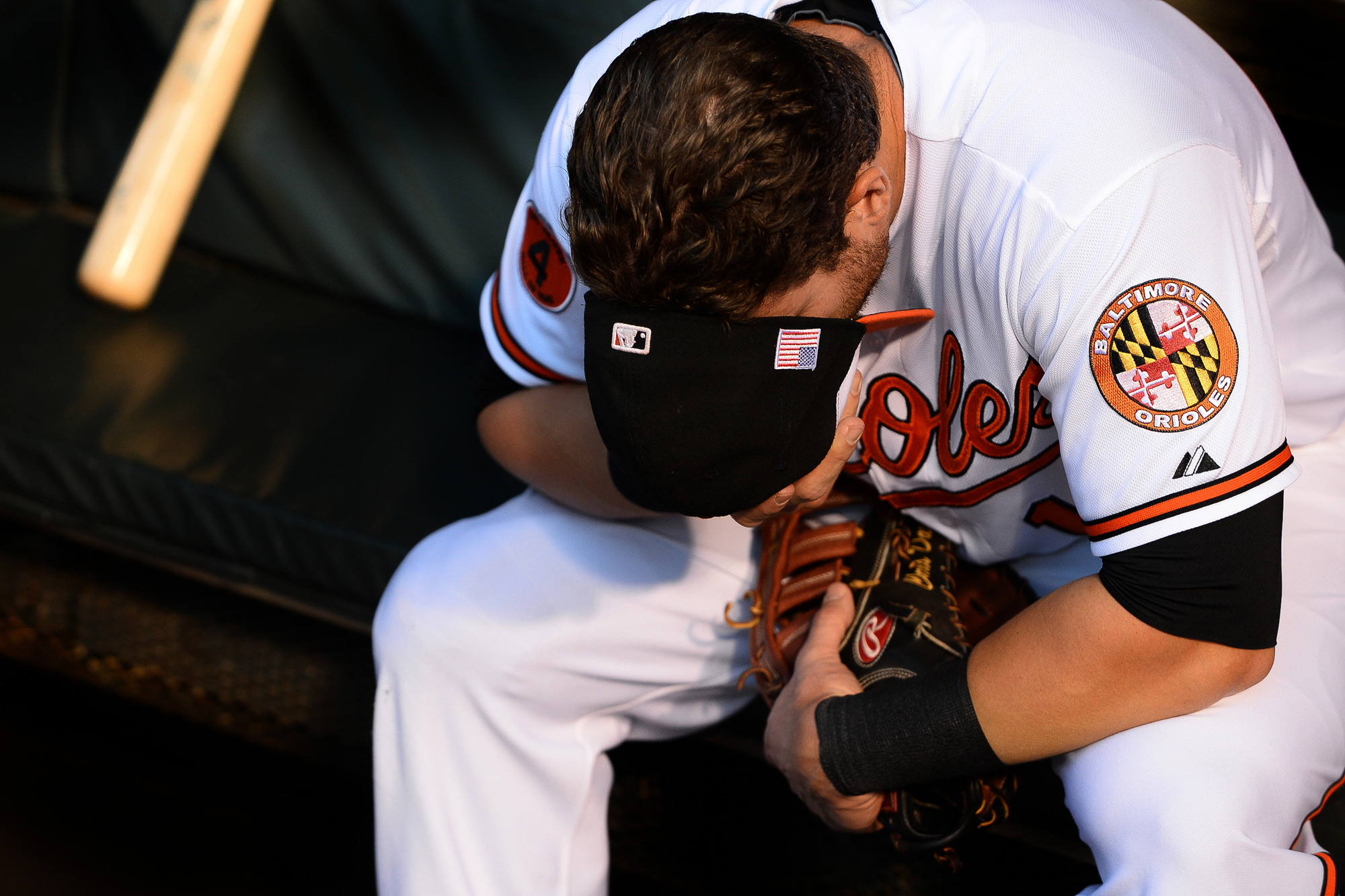 Baltimore Orioles first baseman Chris Davis removes his hat and covers  his face in thought while preparing for a home game against the New York  Yankees on Sept. 11, 2013 in Baltimore, Md. Davis put up 53 home runs in the 2013 season, a new franchise record.