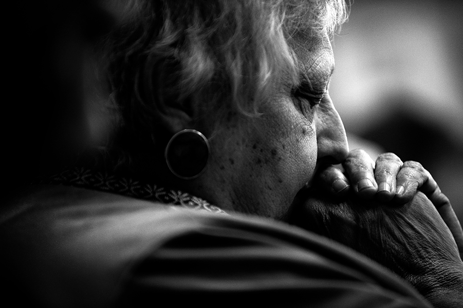 Pat Gurbelski of Violetville takes a moment to reflect during the Saint Charles of Brazil Parish service on April 6, 2014 in Arbutus, Md.
