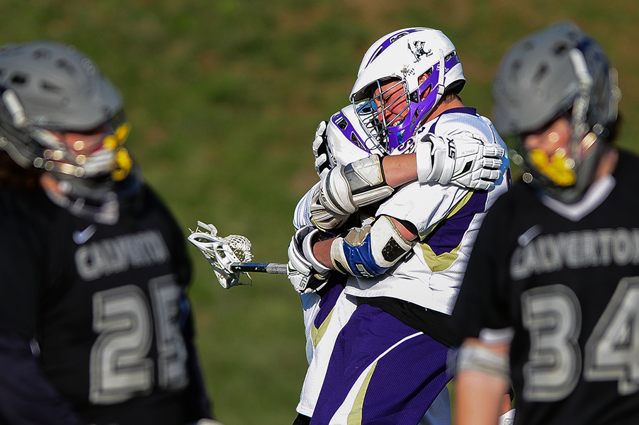 Mount Saint Joseph's Brett Altenburg, second from left, celebrates with Sam Sears after Sears scores during a game against Calverton on April 17, 2014 in Baltimore, Md.