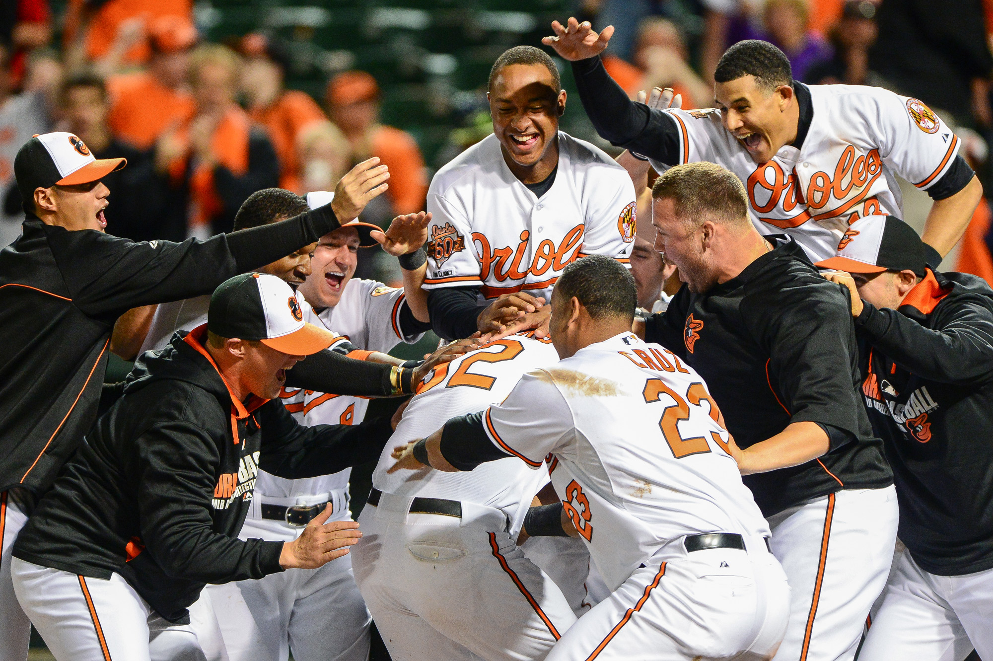 Baltimore Orioles' Matt Wieters is swarmed by his teammates at home plate after hitting the walk-off home run to beat the Pittsburgh Pirates in the 10th inning at Oriole Park at Camden Yards in Baltimore, Maryland on May 1, 2014