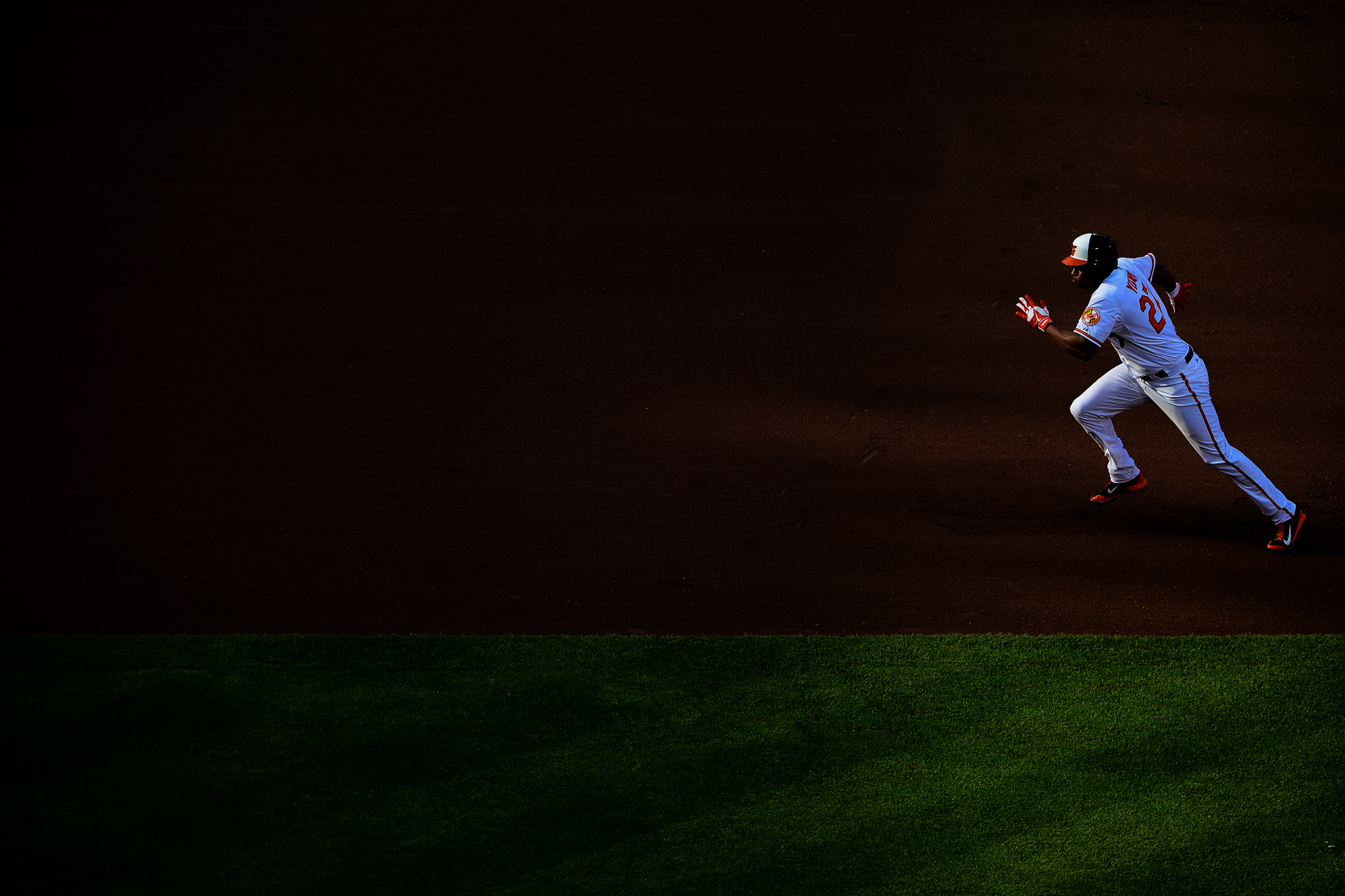 Baltimore Orioles' Delmon Young runs toward third base during a home game against the Pittsburgh Pirates at Oriole Park at Camden Yards in Baltimore, Maryland on May 1, 2014.