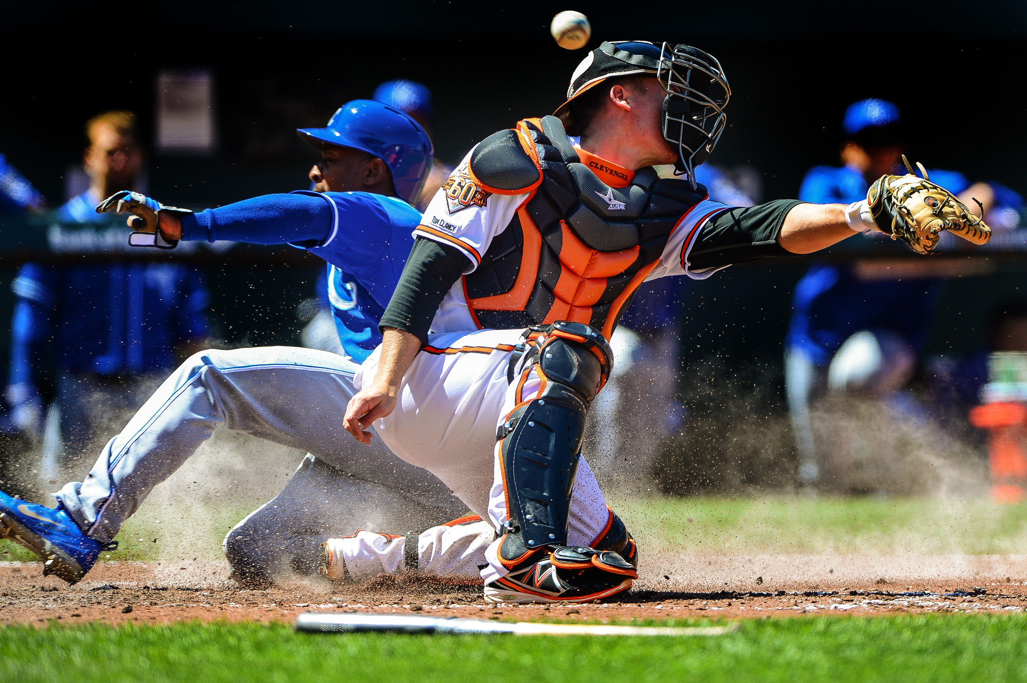 Baltimore Orioles catcher Steve Clevenger misses the play at home while Jarrod Dyson of the Kansas City Royals scores at Oriole Park in Camden Yards in Baltimore, Md. on April 27, 2014.