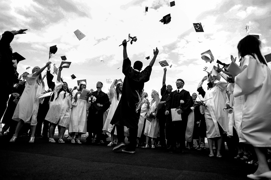 The Perryville High School class of 2014 celebrates at the conclusion of their graduation ceremony on June 5, 2014 in Perryville, Maryland.
