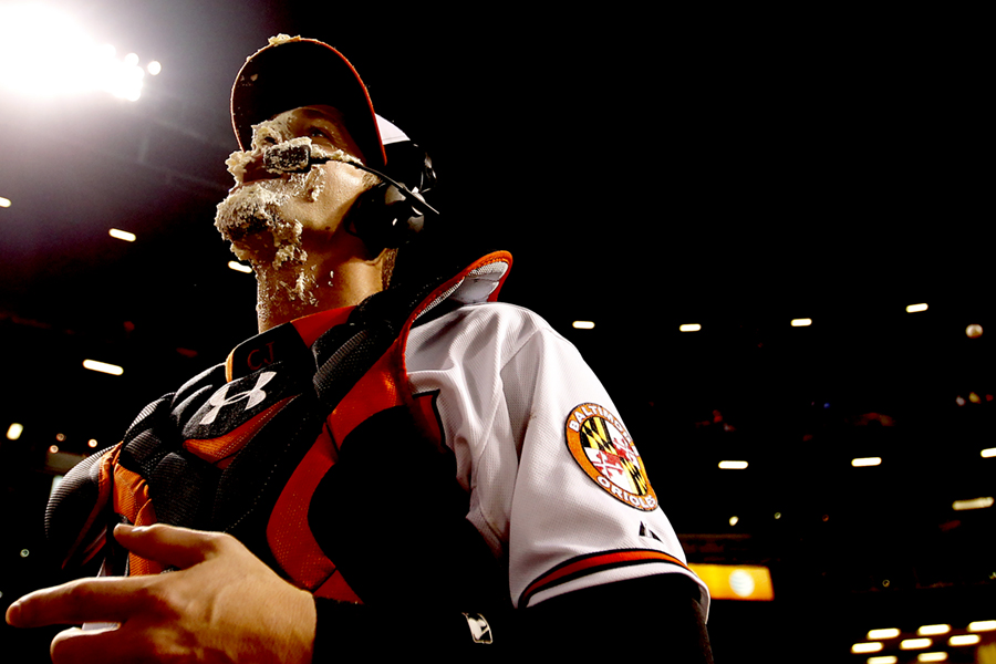 Baltimore Orioles catcher Caleb Joseph licks pie off of his face after the conclusion of a MLB game against the Toronto Blue Jays at Oriole Park at Camden Yards in Baltimore, Maryland on June 12, 2014