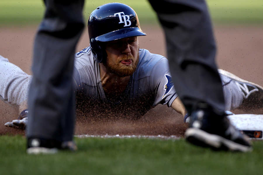Ben Zobrist of the Tampa Bay Rays slides safely into third base during a MLB game against the Baltimore Orioles on July, 28, 2014 at Oriole Park at Camden Yards in Baltimore, Maryland.