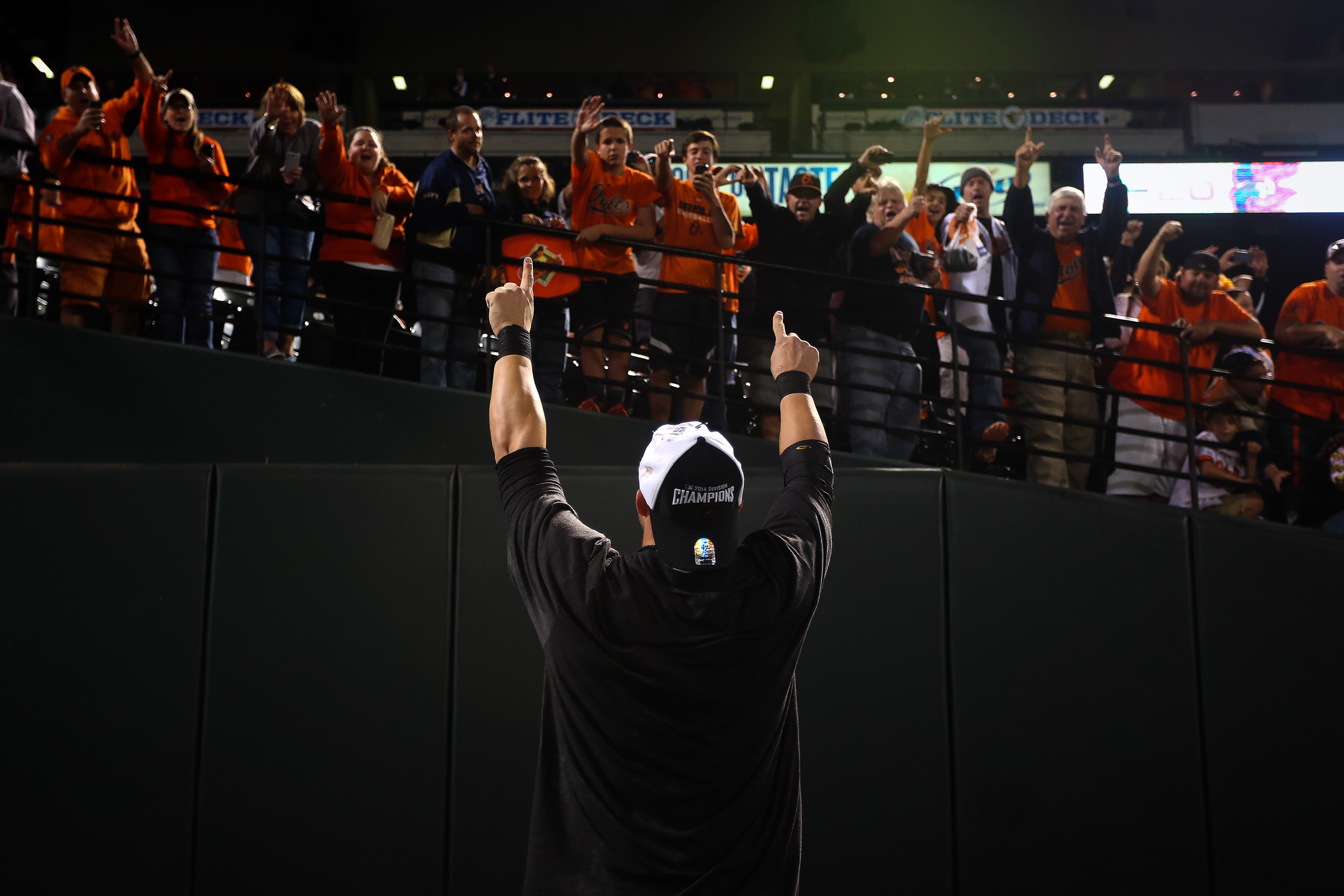 First baseman Steve Pearce of the Baltimore Orioles celebrates with fans after the Orioles defeated the Toronto Blue Jays to clinch the American League East Division at Oriole Park at Camden Yards in Baltimore, Maryland on Sept. 16, 2014.