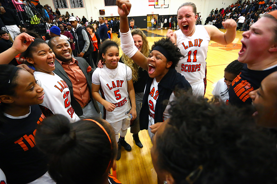 Ny'Jayah Lockwood, center, of Oakland Mills charges into the celebration after Oakland Mills defeated during the 2A south region championship game in Columbia on Monday, March 9, 2015.