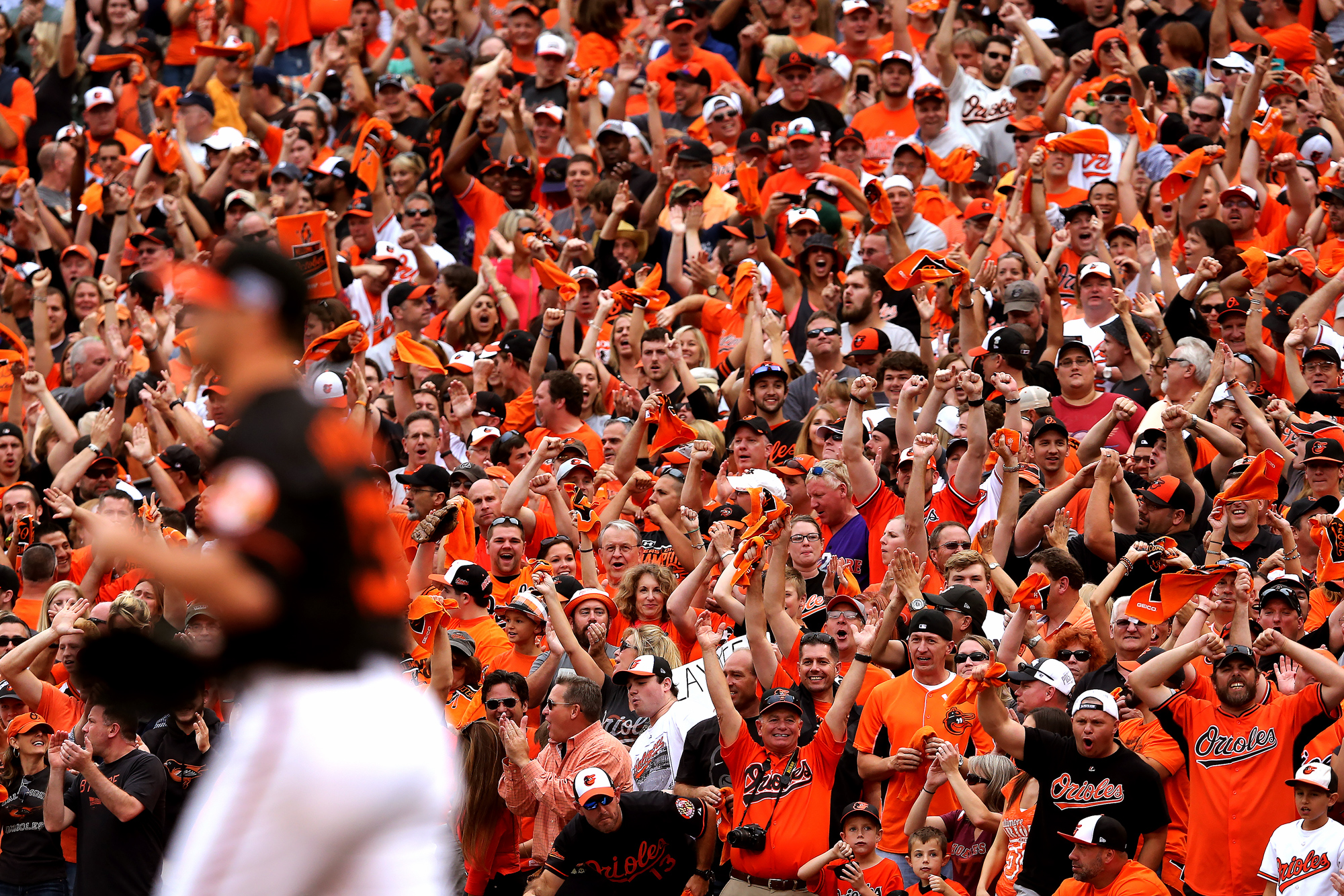 Fans cheer at the conclusion of Game Two of the American League Division Series against the Detroit Tigers at Oriole Park at Camden Yards on October 3, 2014 in Baltimore, Maryland.