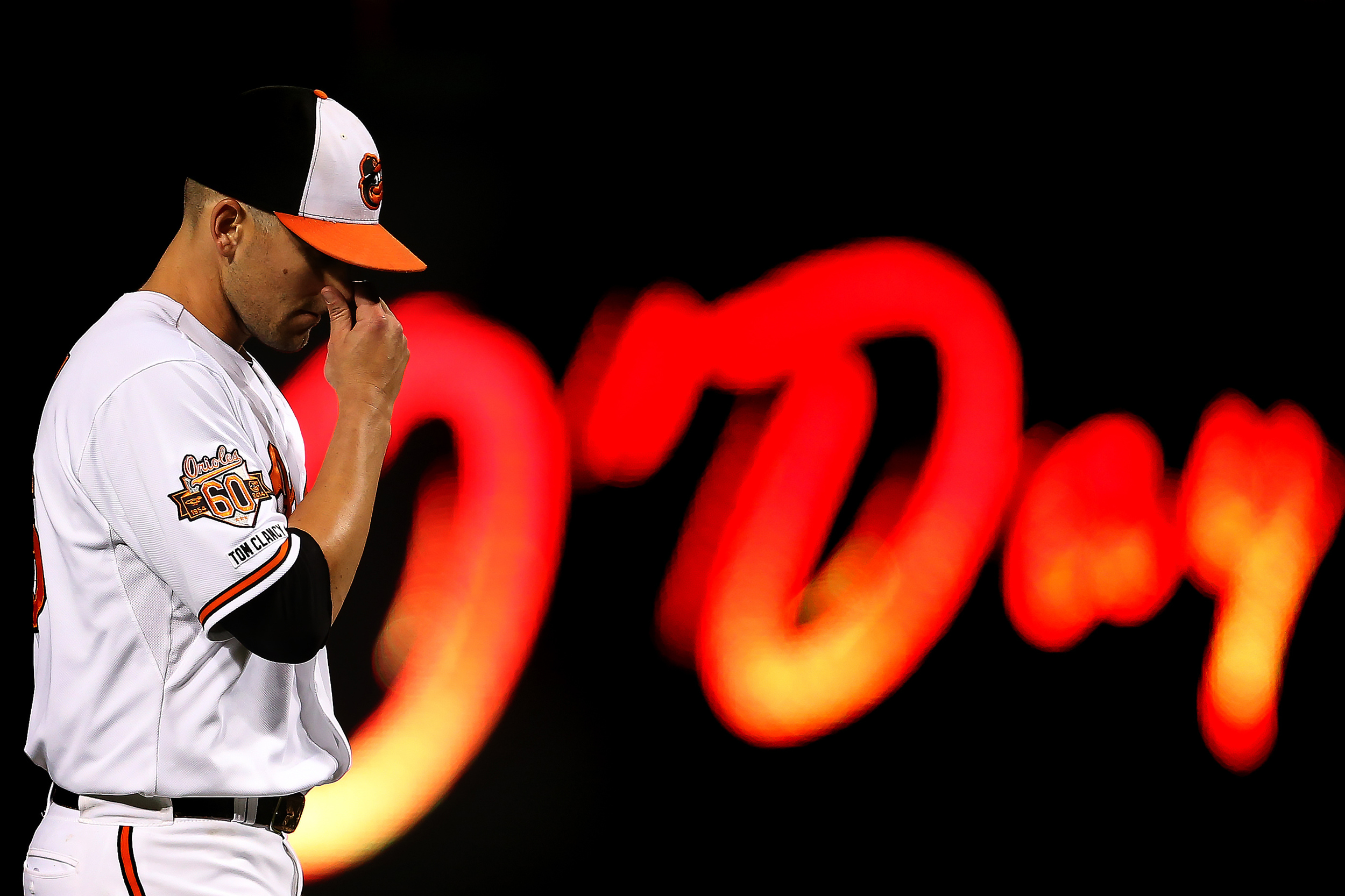 Pitcher Darren O'Day of the Baltimore Orioles walks off the field during a MLB game against the Toronto Blue Jays on Sept. 16, 2014 at Oriole Park at Camden Yards in Baltimore, Maryland.