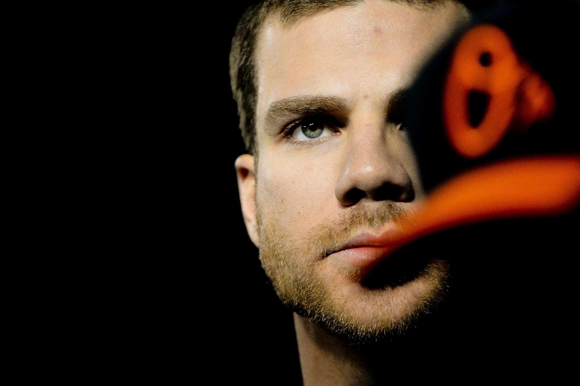 Baltimore Orioles first baseman Chris Davis stands in the dugout before preparing for an at bat in the first inning of a home game on April 25, 2014 in Baltimore, Md.