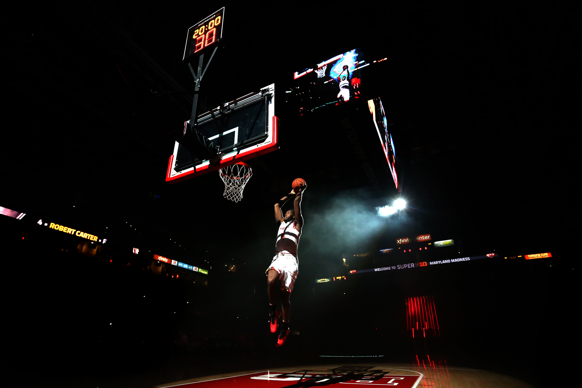 Robert Carter of University of Maryland dunks after being introduced during Maryland Madness at Xfinity Center in College Park on Friday, Oct. 17, 2014.