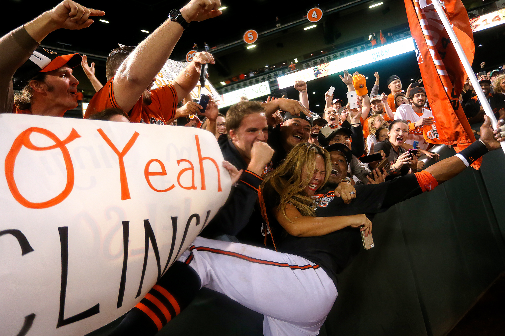 Center fielder Adam Jones of the Baltimore Orioles celebrates with fans after the Orioles defeated the Toronto Blue Jays to clinch the American League East Division at Oriole Park at Camden Yards in Baltimore, Maryland on Sept. 16, 2014.