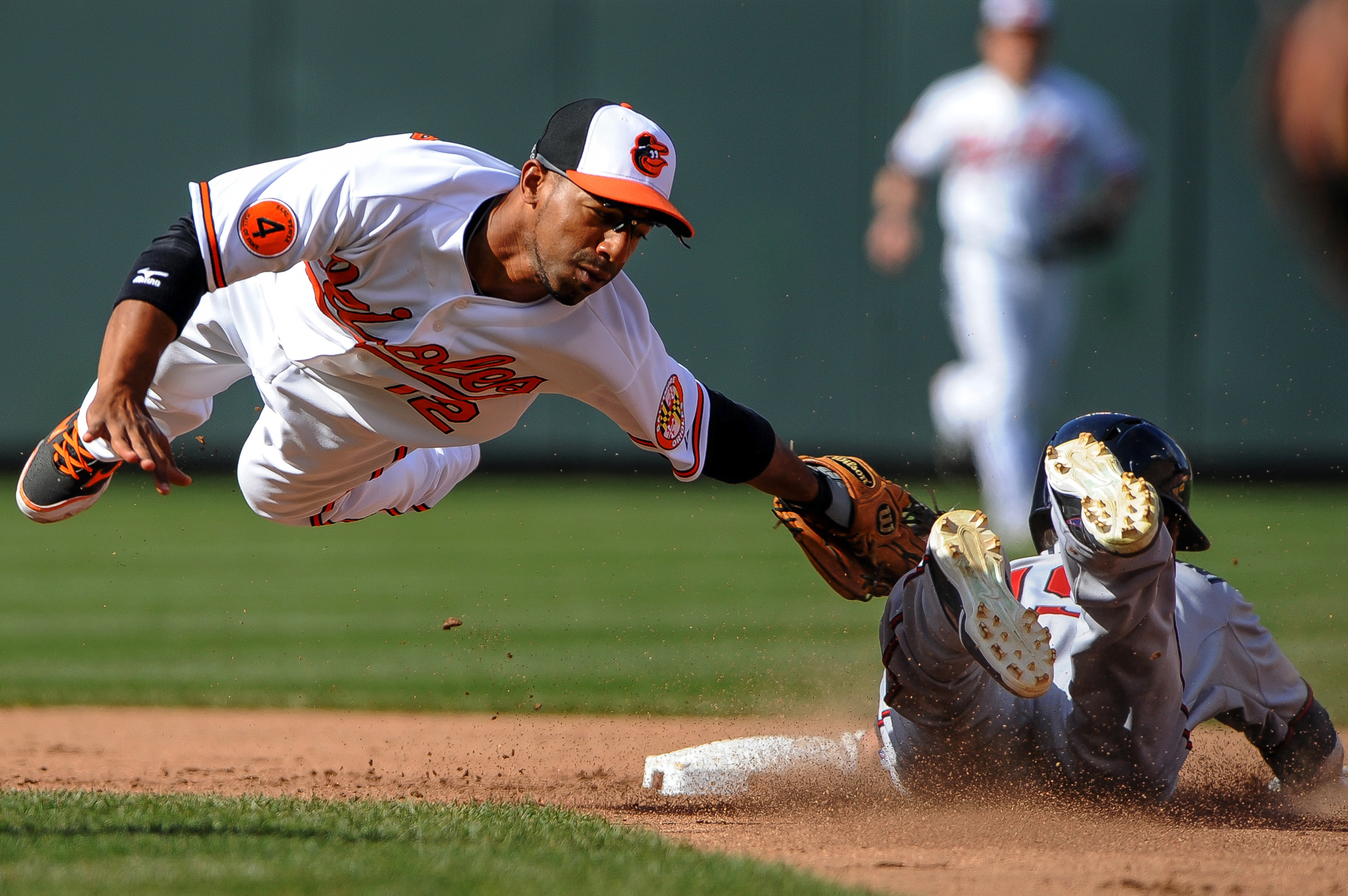 Baltimore Orioles second baseman Alexi Casillas makes the tag in the top of the fifth inning against the Minnesota Twins on April 7, 2013 in Baltimore, Md.