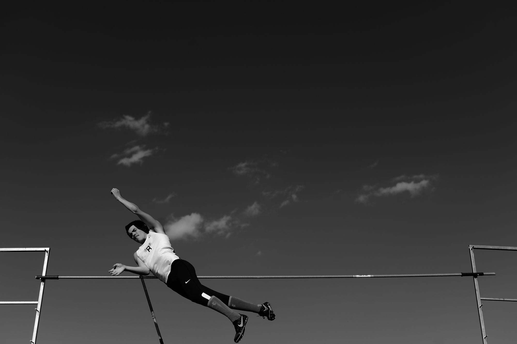 Dan Larkin of Reservoir High School competes in the pole vault competition on the second day of the Howard County Track Championships at Wilde Lake High School in Columbia, Maryland on May 6, 2014.
