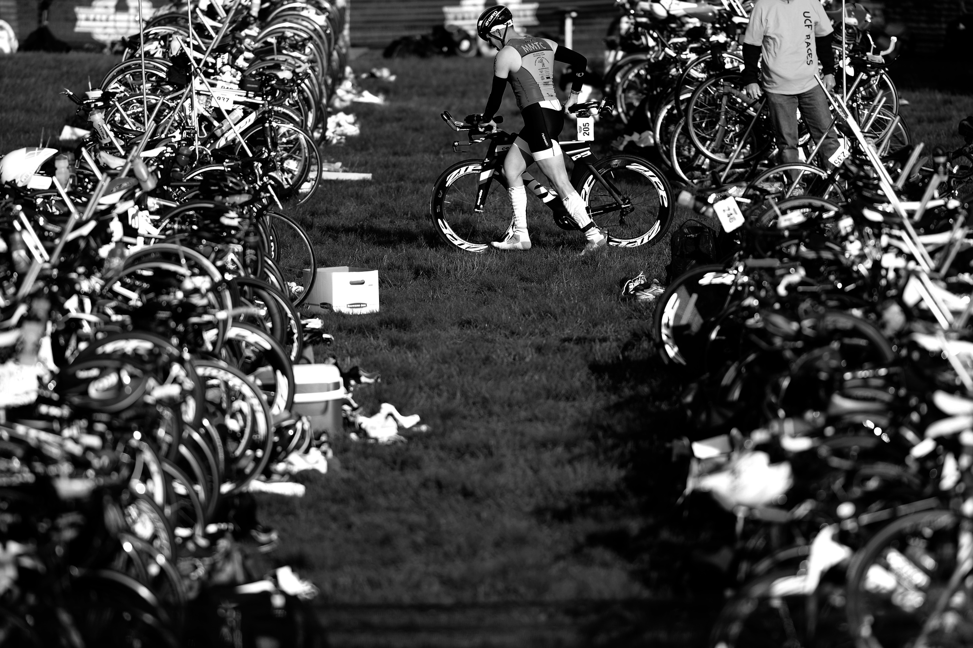 A participant of the 31st annual Columbia Triathlon at Centennial Park grabs his bike during the race in Ellicott City, Maryland on May 18, 2014.