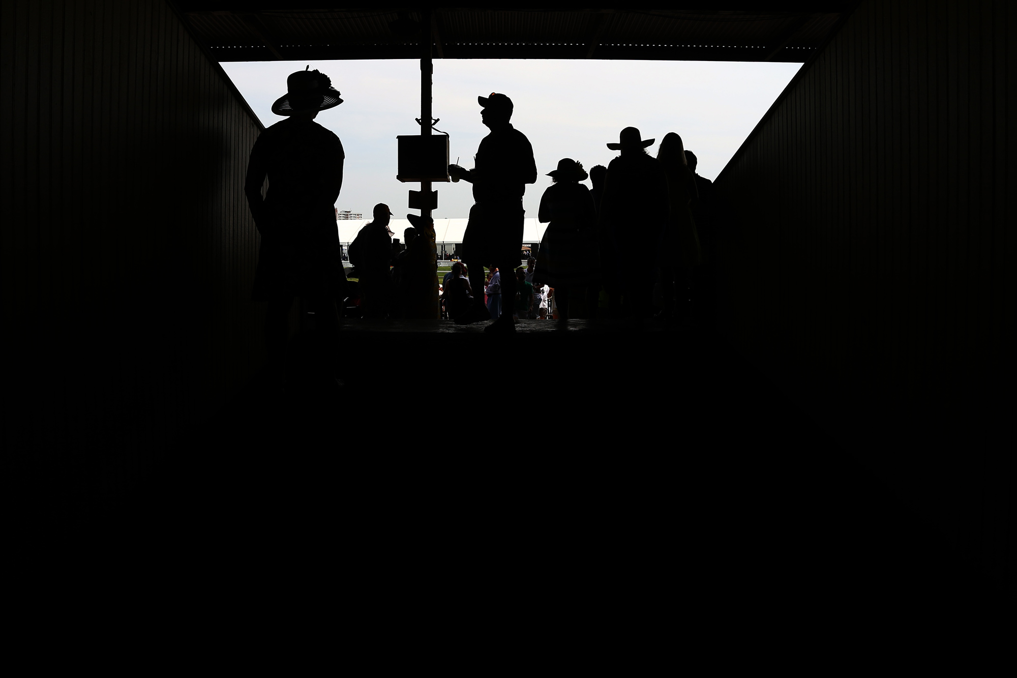 Fans walk through the grandstand before the start of the 140th Preakness Stakes at Pimlico Race Course on May 16, 2015 in Baltimore, Maryland.