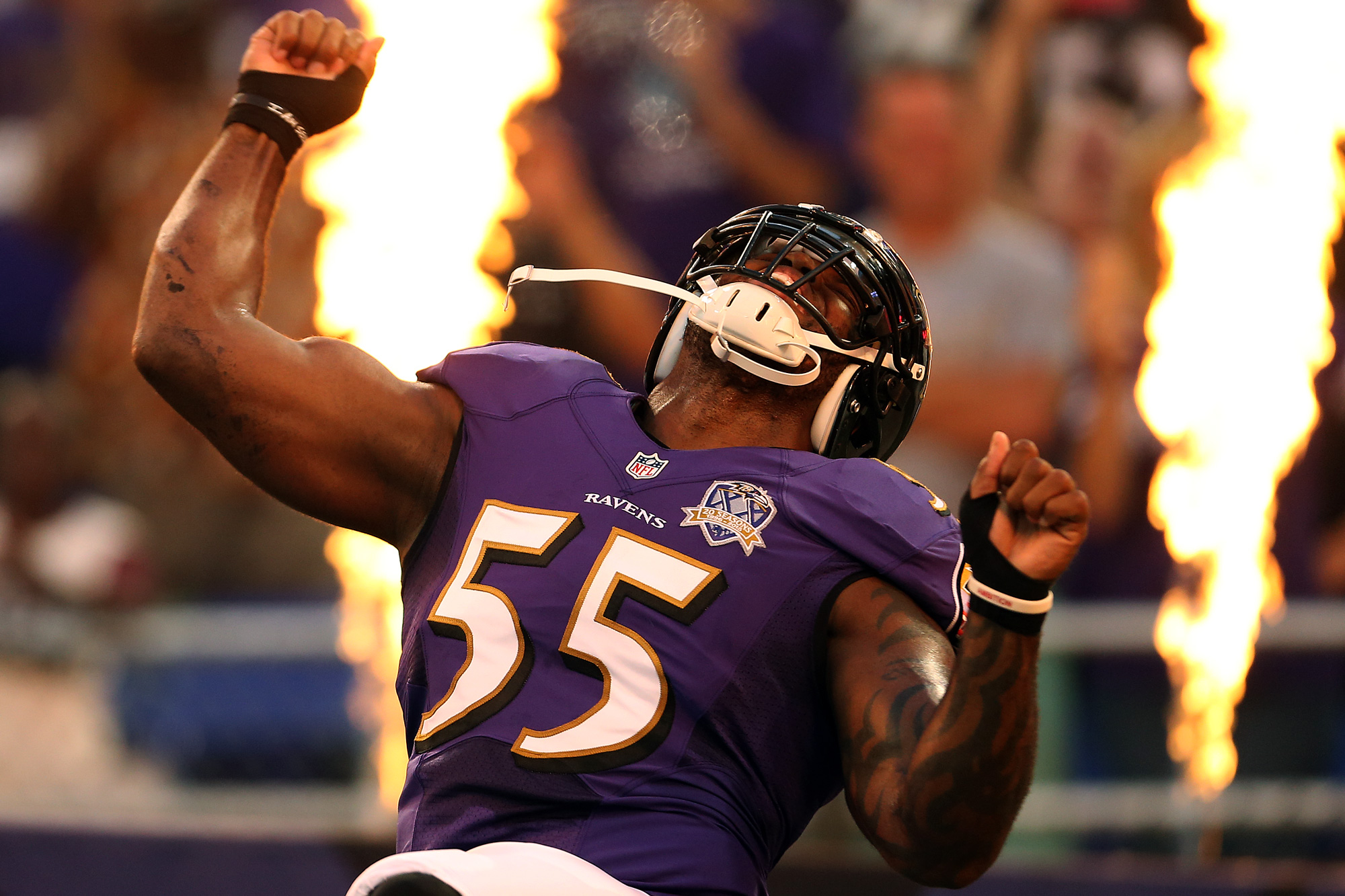Outside linebacker Terrell Suggs #55 of the Baltimore Ravens is introduced prior to the start of a preseason game against the Washington Redskins at M&T Bank Stadium on August 29, 2015 in Baltimore, Maryland.