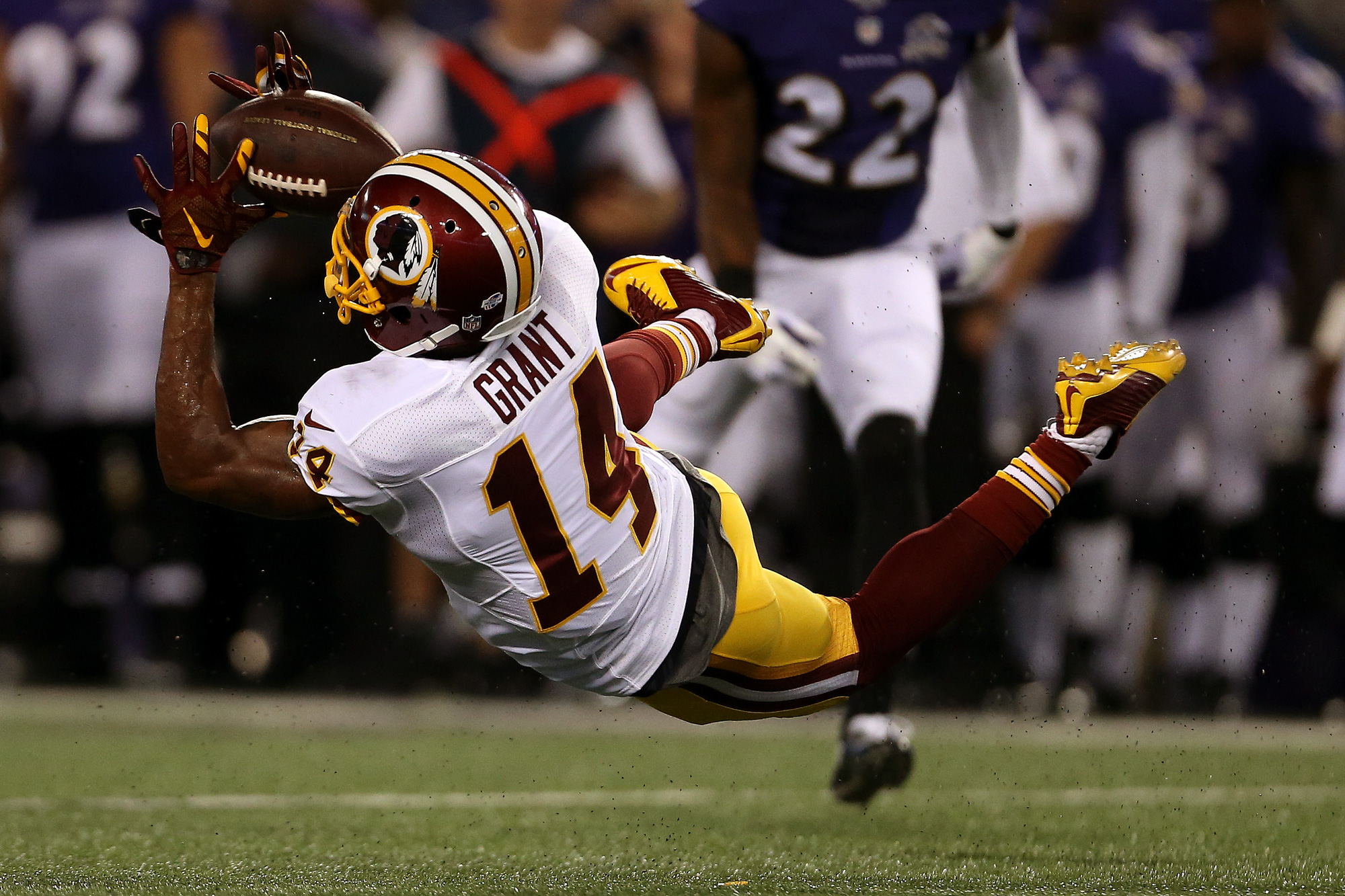Wide receiver Ryan Grant #14 of the Washington Redskins misses a catch in the first quarter of a preseason game against the Baltimore Ravens at M&T Bank Stadium on August 29, 2015 in Baltimore, Maryland.