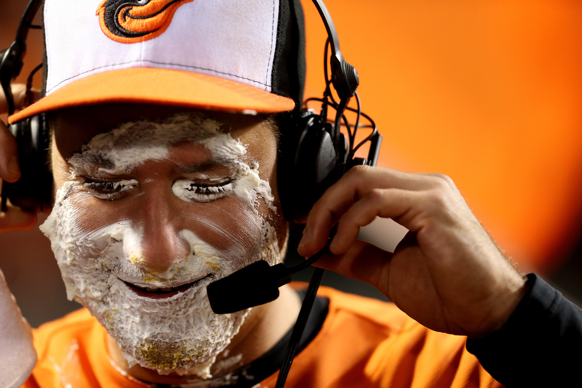 Paul Janish #15 of the Baltimore Orioles looks on after getting pied after defeating the New York Yankees at Orioles Park at Camden Yards on October 3, 3015 in Baltimore, Maryland.