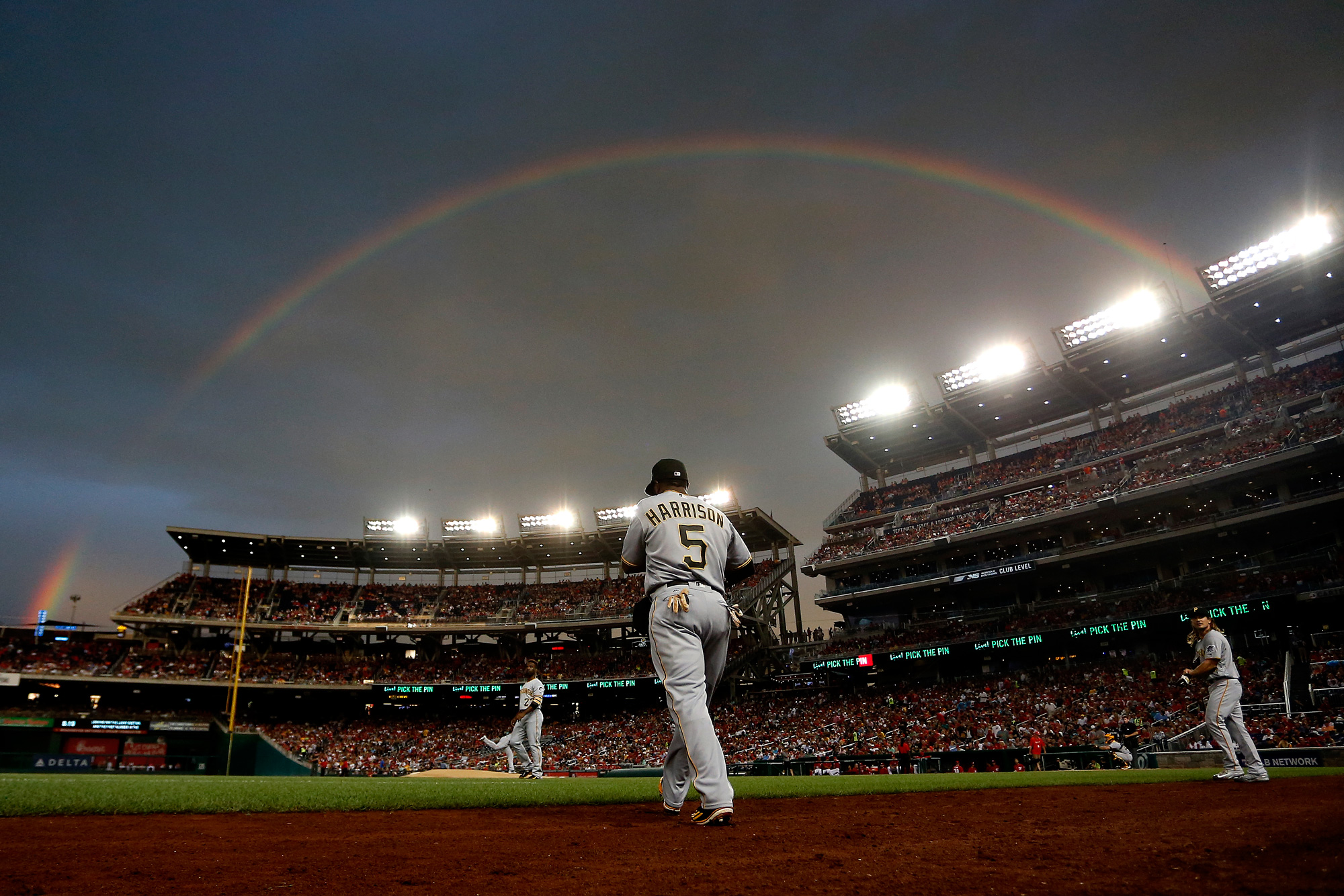 Josh Harrison #5 of the Pittsburgh Pirates walks onto the field under a rainbow in the first inning against the Washington Nationals at Nationals Park on July 16, 2016 in Washington, DC.