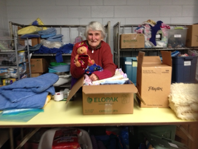 Brigid a long time 'Friend of Mengo' packing linen at the CRW