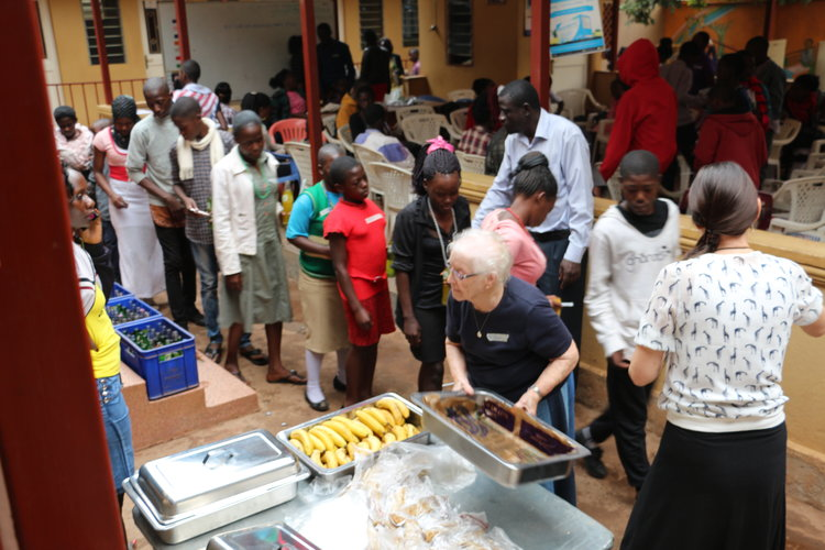 Serving lunch to AIDS orphans