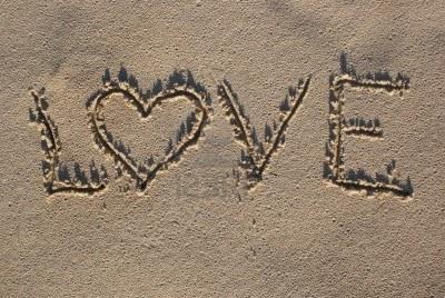 4294110-love-sign-written-on-sand-with-heart-shape-1.jpg