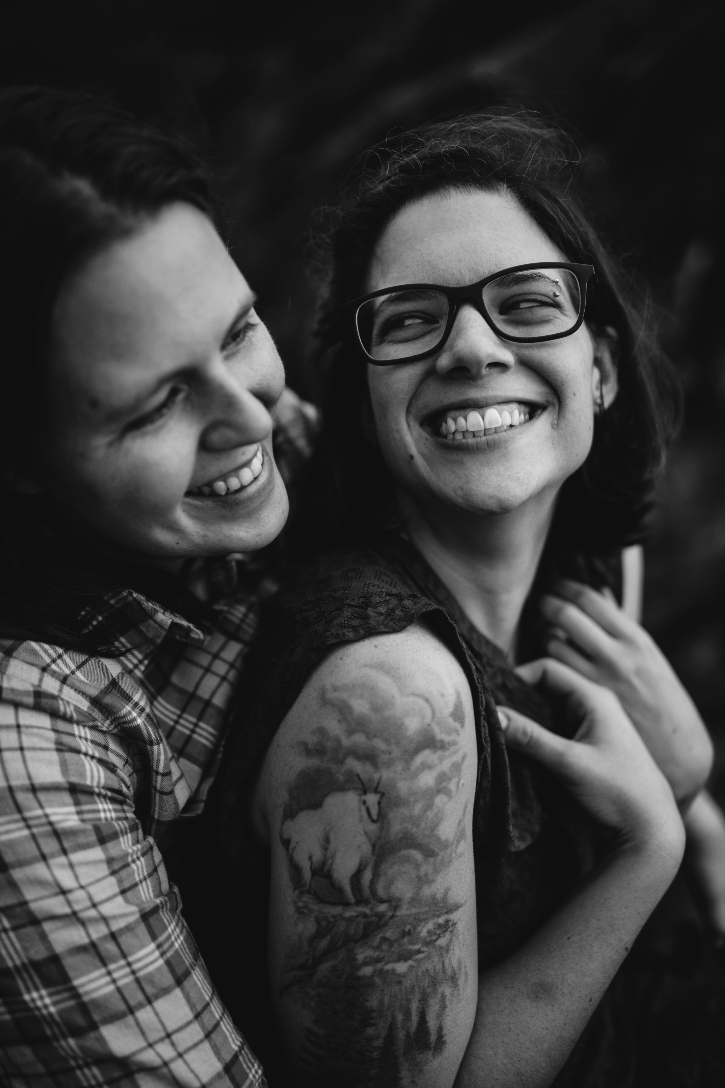 Feminist Wedding Photography Carly Romeo Photography Richmond VA Charlottesville Humpback Rock Hike Dogs Engagement Skyline Queer Women Smile Black and White