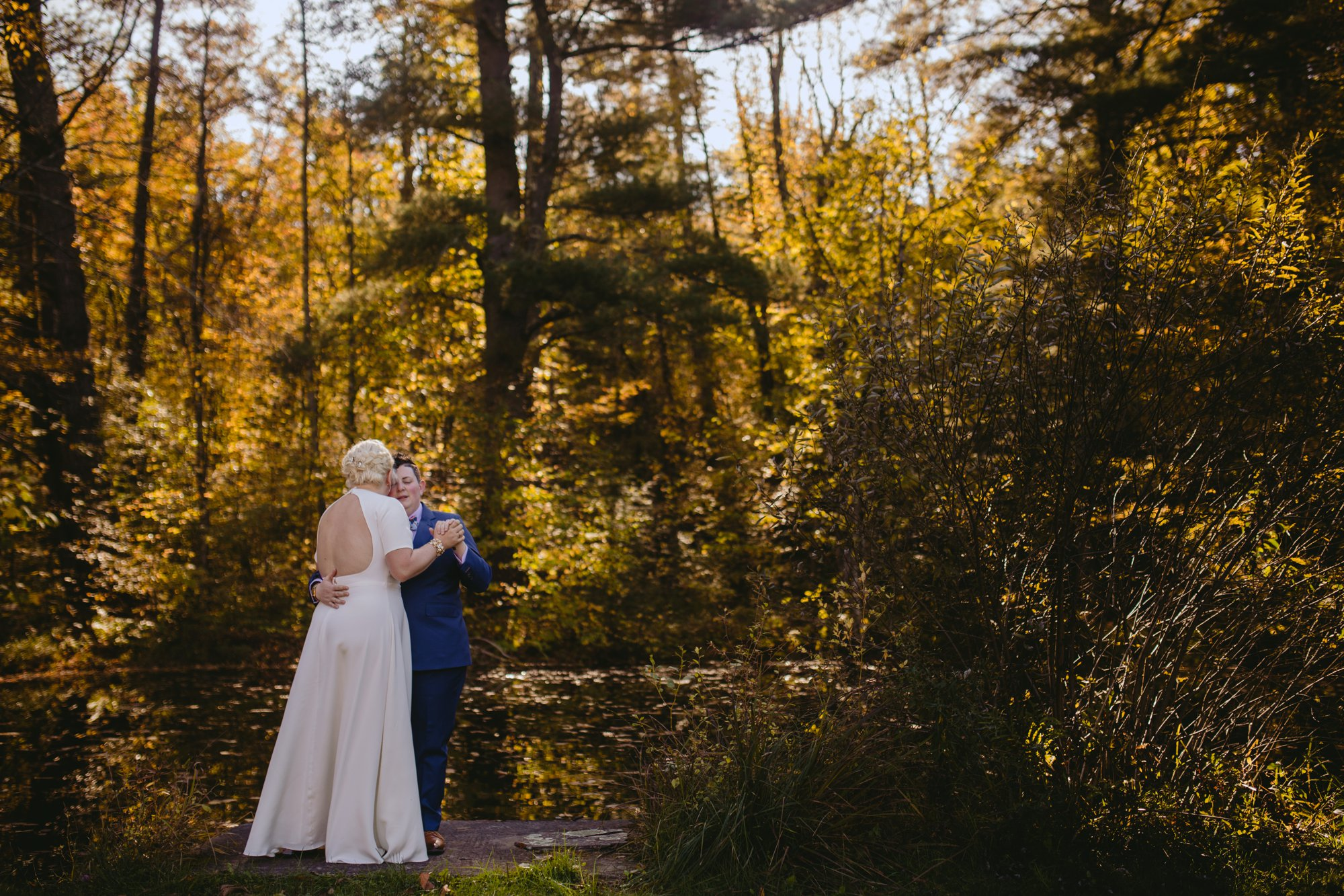 October Jewish lesbian wedding at Foxfire Mountain House in Upstate New York. Dancing in forest.