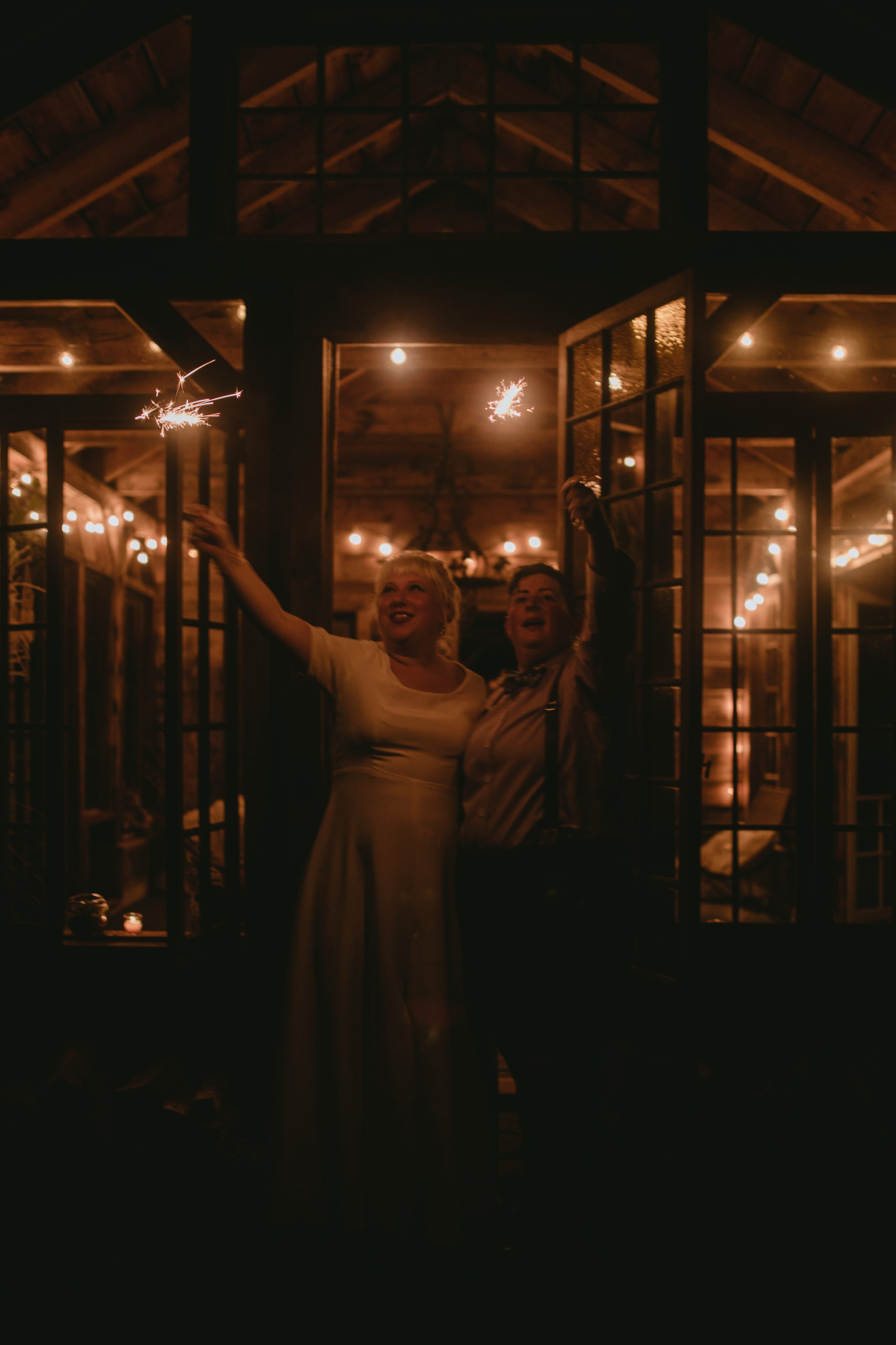 October Jewish lesbian wedding at Foxfire Mountain House in Upstate New York. End of night sparklers