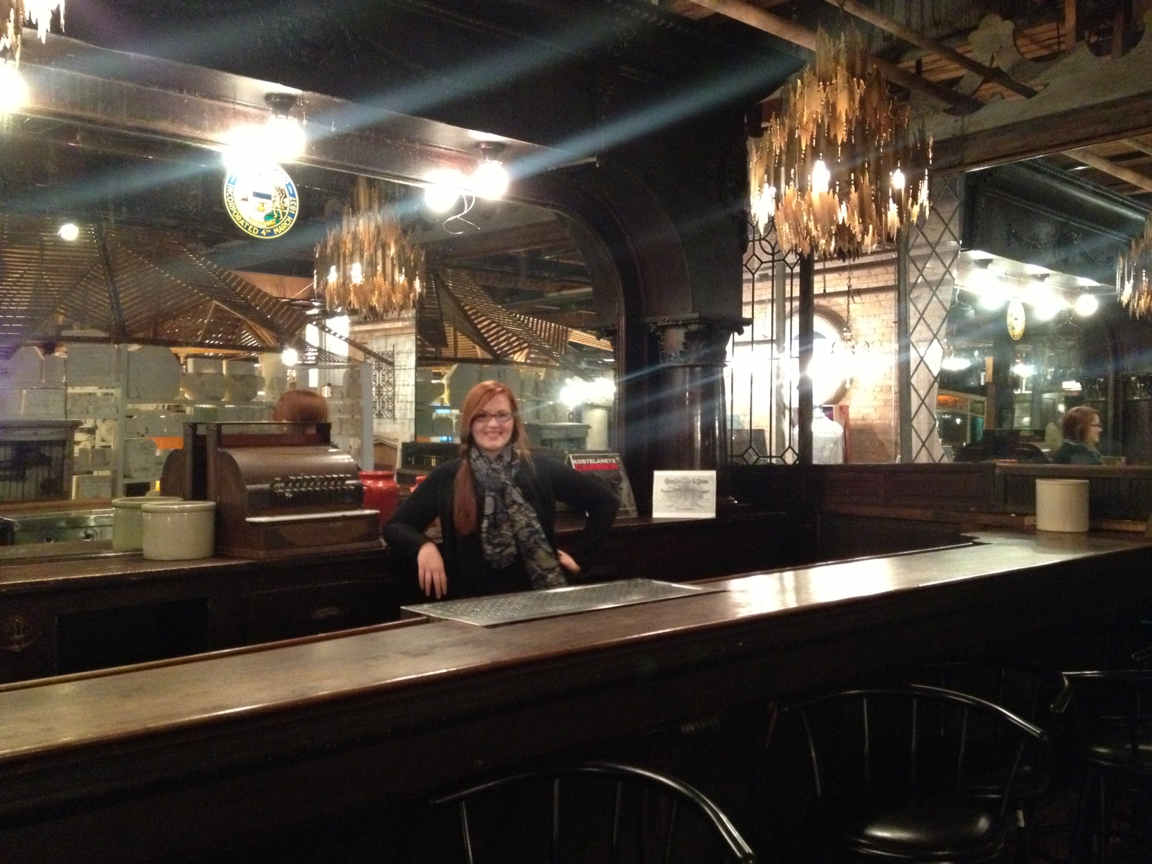Theresa McMullen poses by one of the many vintage bar setups at Salvage One, Chicago IL.