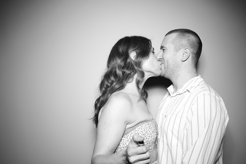 A picture of Linda and Dennis Tisdale rocking a photo booth kiss!
